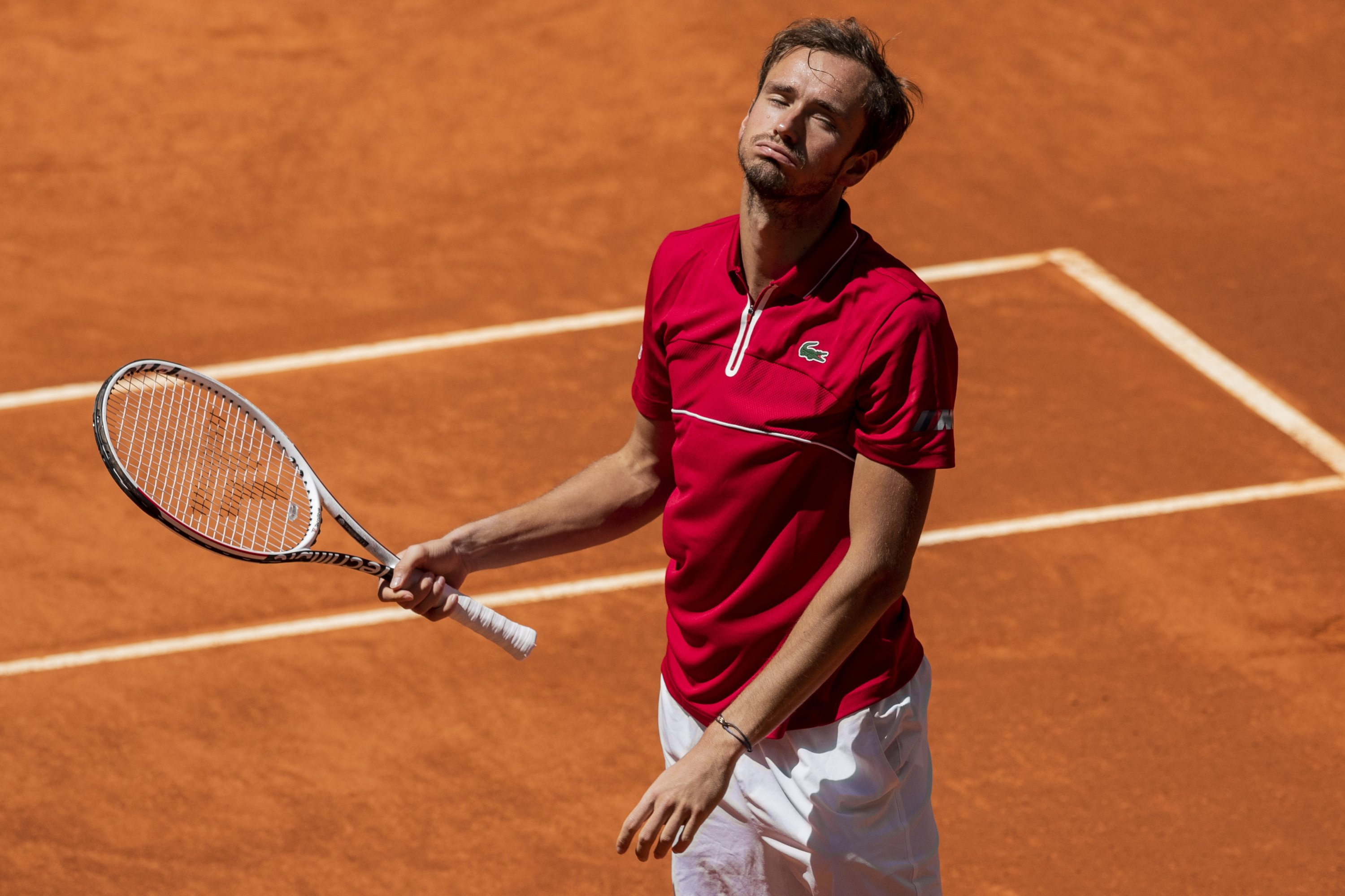 Russia's Daniil Medvedev reacts after missing a point against Chile's Cristian Garin during their Mutua Madrid Open match, Madrid, Spain, May 6, 2021. (AP Photo)
