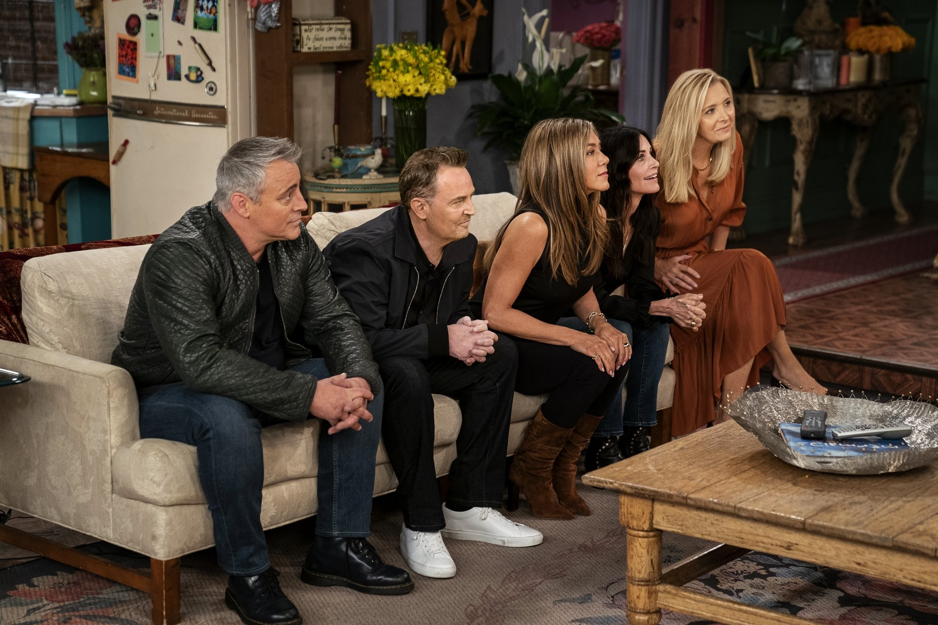 From the left Matt LeBlanc, Matthew Perry, Jennifer Aniston, Courteney Cox andLisa Kudrow sit on thesofa in the famous apartment from the television series 'Friends' during the reunion special. (HBO Max via AP)