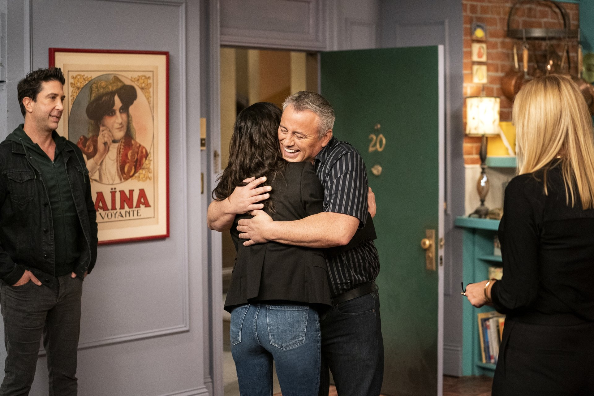 Courtney Cox (C-L) and Matt LeBlanc (C-R) hug each other as David Schwimmer (L) and Jennifer Aniston look on, during the reunion special of the populartelevision series 'Friends.'(HBO Max via AP)