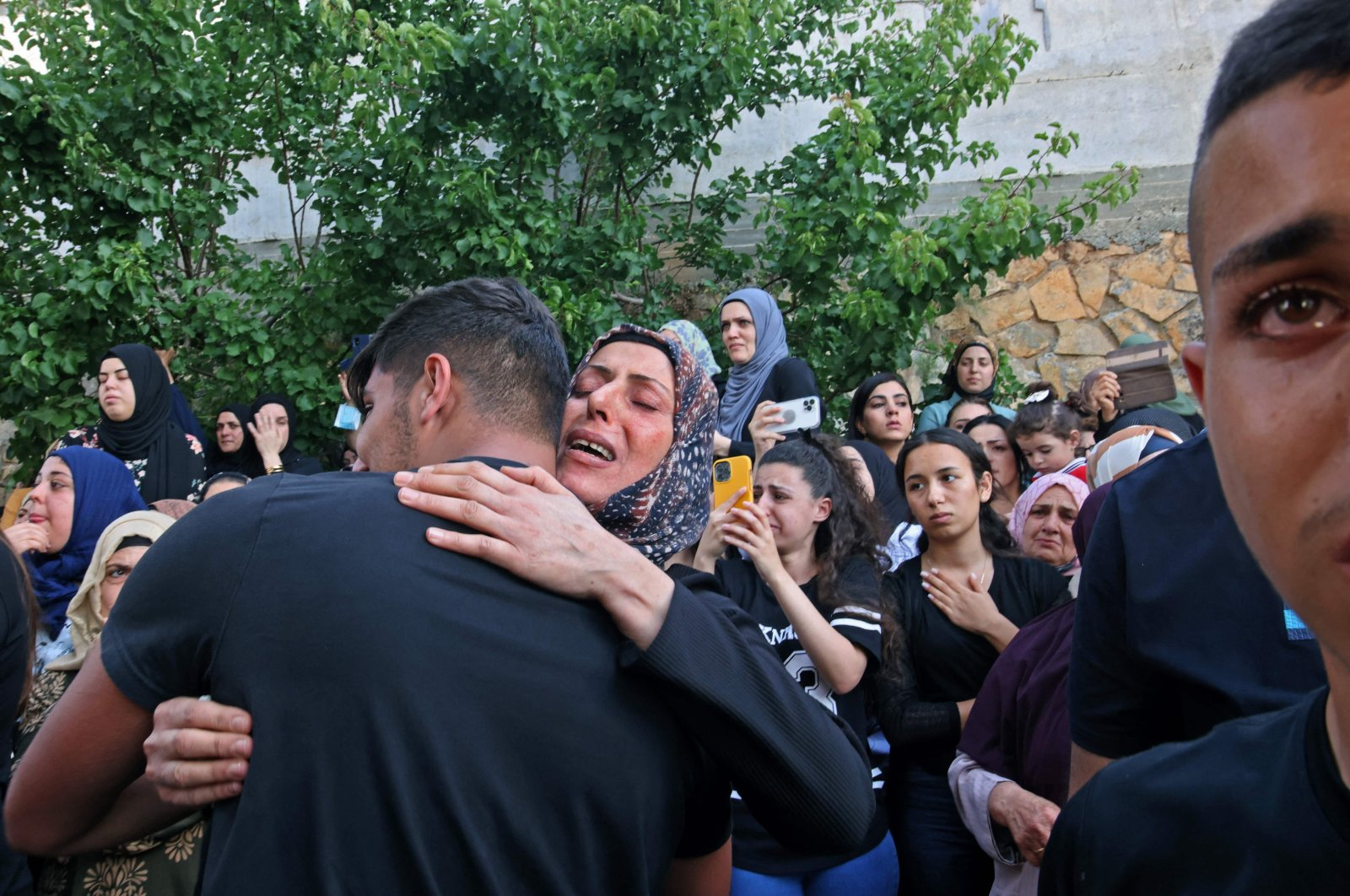Mourners react during the funeral of Mohammad Kiwan, a 17-year-old Palestinian who succumbed to his wounds after being shot by Israeli forces, in Umm al-Fahm, northern Israel, May 20, 2021. (AFP Photo)