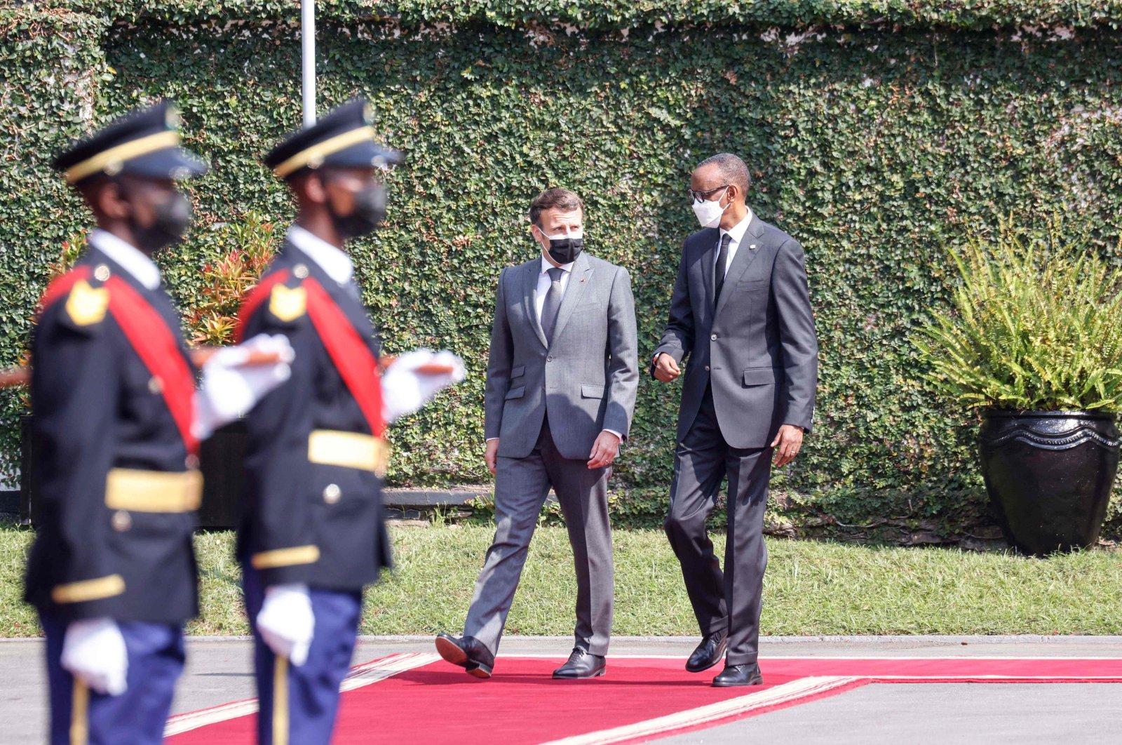 Rwandan President Paul Kagame (R) receives French President Emmanuel Macron at the Presidential Palace in Kigali, Rwanda, May 27, 2021. (AFP Photo)