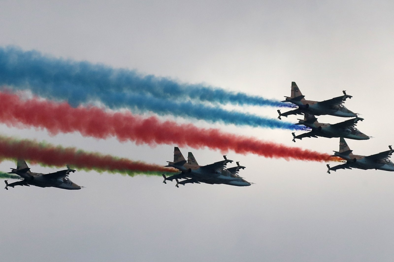 Sukhoi Su-25 jet fighters leave a trail in Azerbaijani national colors during a military parade marking the end of the Nagorno-Karabakh military conflict, Baku, Azerbaijan, Dec. 10, 2020. (Photo by Getty Images)