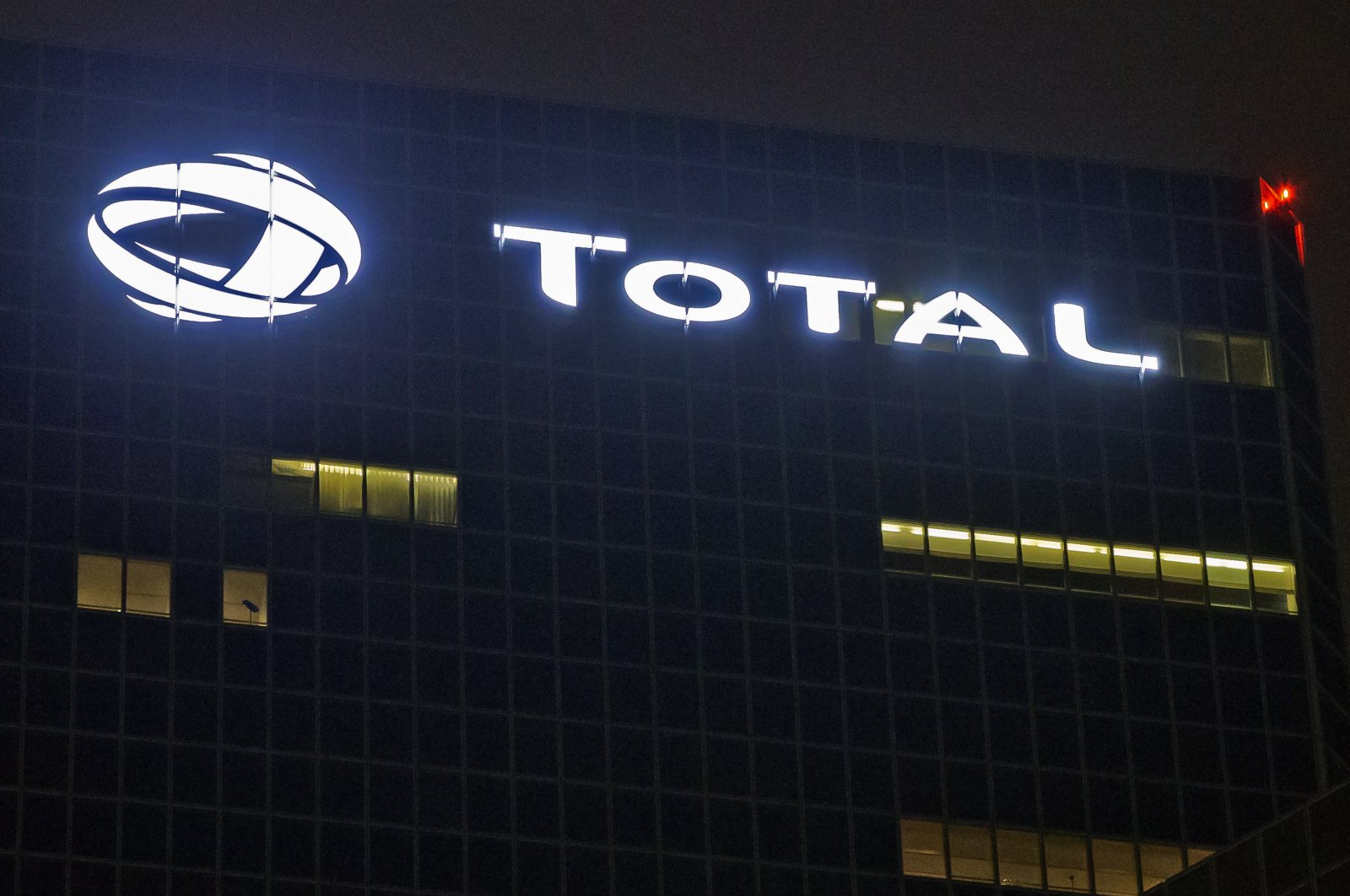 The logo of French oil giant Total SA is pictured at company headquarters in La Defense business district, outside Paris, France, Oct. 12, 2016. (AP Photo)