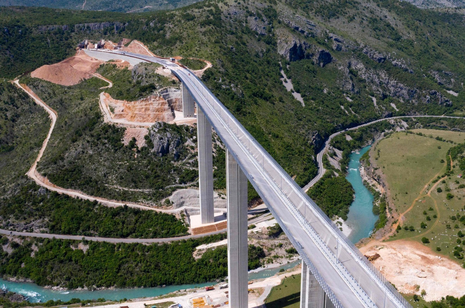 An aerial view shows a part of the new highway connecting the city of Bar on Montenegro's Adriatic coast to landlocked neighbor Serbia, which is being constructed by China Road and Bridge Corporation (CRBC), the large state-owned Chinese company, near Matesevo, Montenegro, May 11, 2021. (AFP Photo)