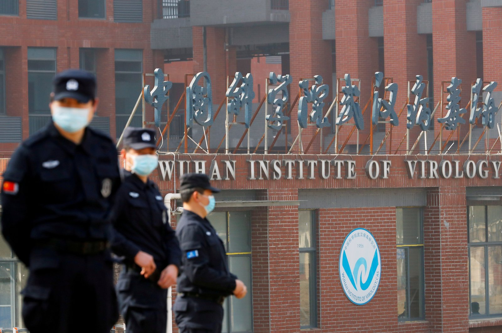 Security personnel keep watch outside the Wuhan Institute of Virology during the visit by the World Health Organization (WHO) team tasked with investigating the origins of the coronavirus disease (COVID-19), inWuhan, Hubei province, China, Feb. 3, 2021. (Reuters Photo)