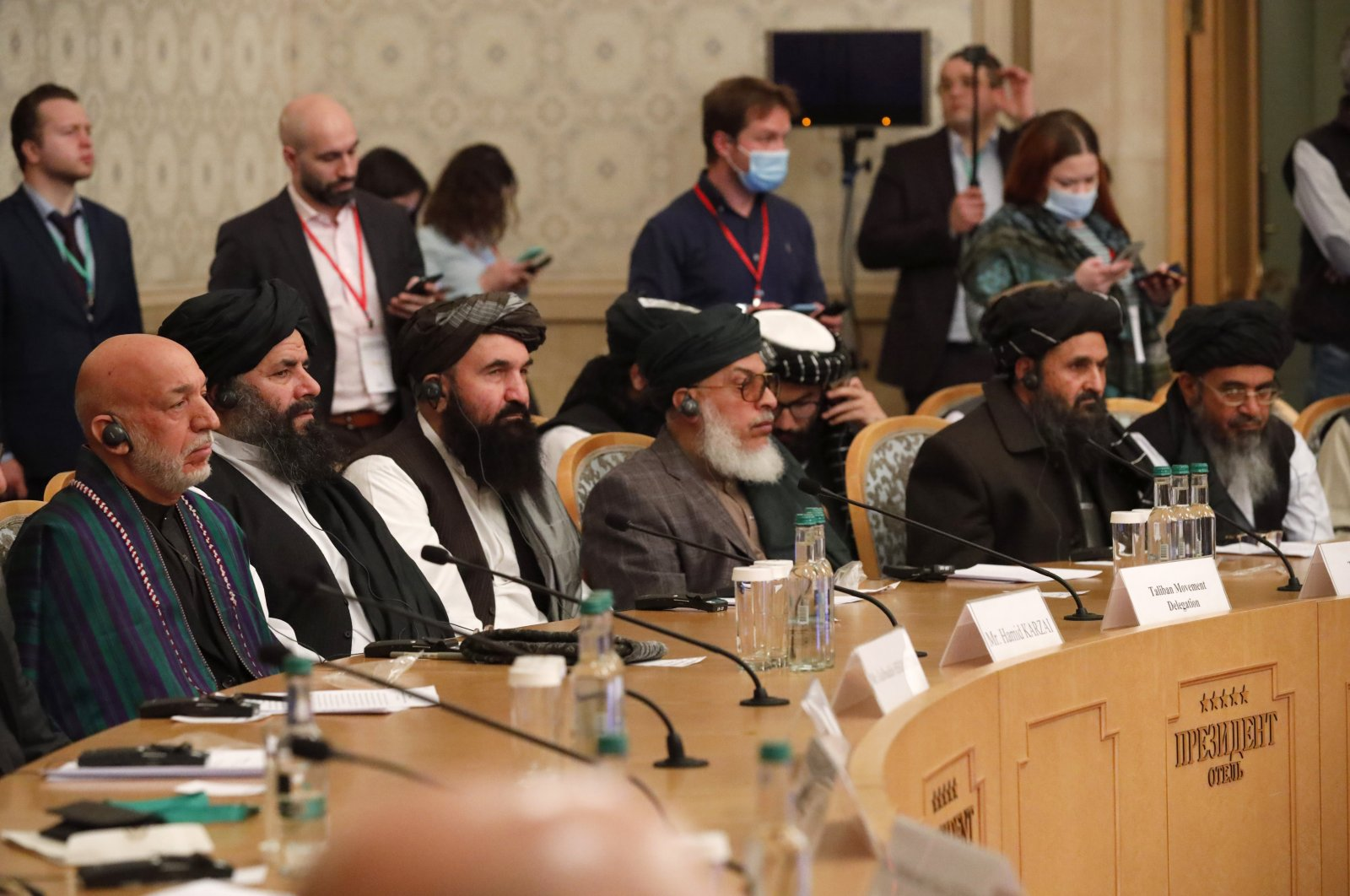 Former President Hamid Karzai (L) and Taliban co-founder Mullah Abdul Ghani Baradar, (2nd R), attend an international peace conference in Moscow, Russia, March 18, 2021. (AP File Photo)