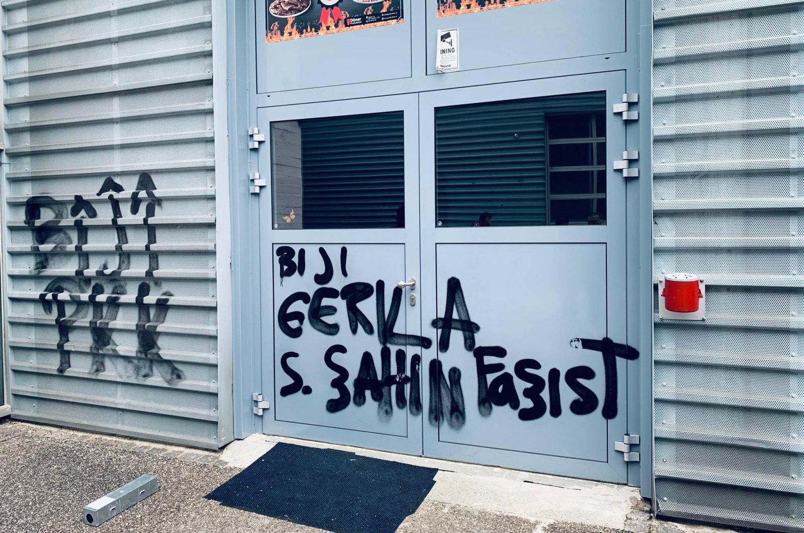 Terrorist PKK propaganda is seen on the walls of the Turkish-owned döner factory in Dulliken, Switzerland, Thursday, May 27, 2021. (AA Photo)