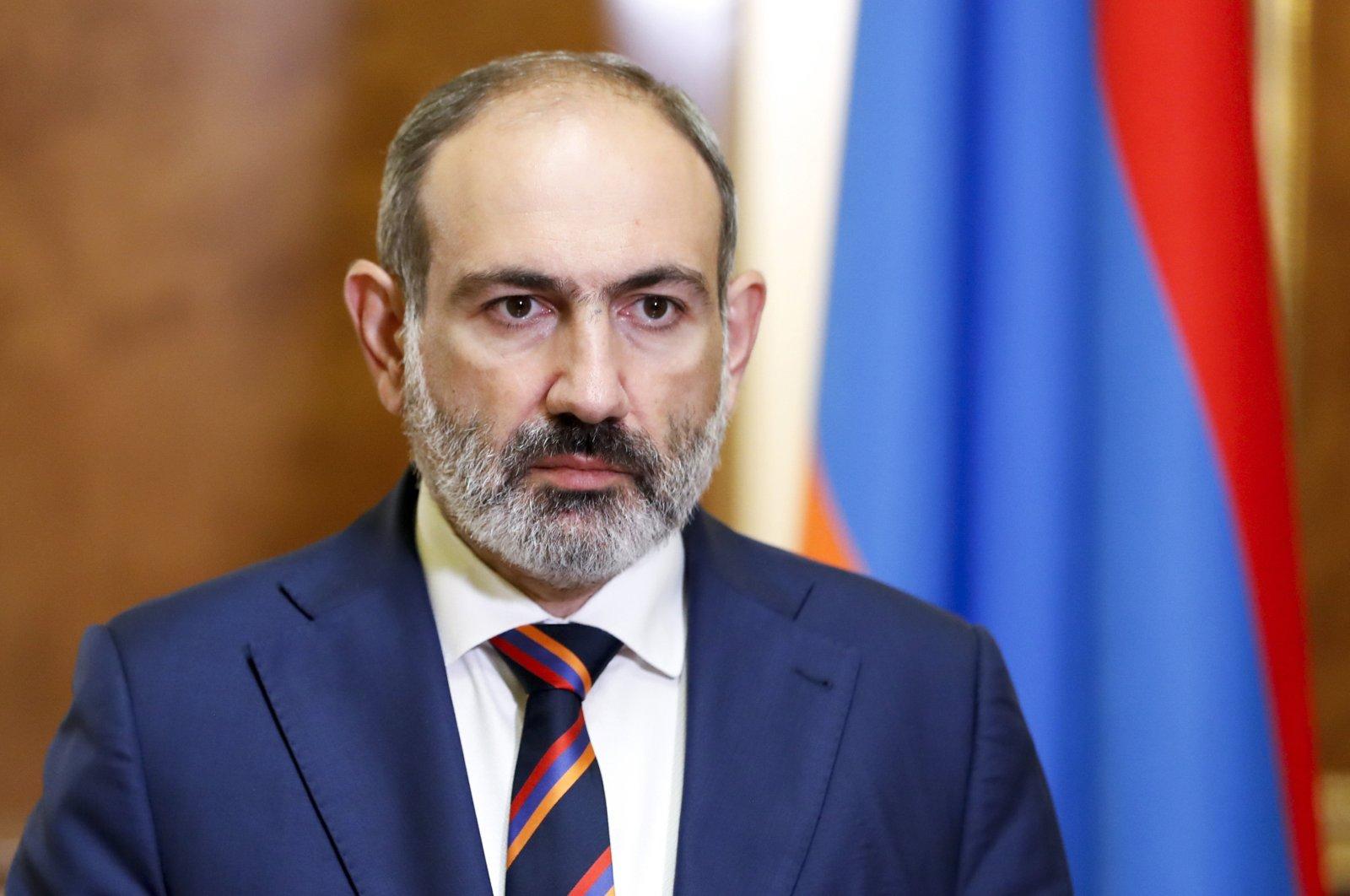Armenian Prime Minister Nikol Pashinian pauses as he speaks at the Armenian Parliament in Yerevan, Armenia, Sunday, Sept. 27, 2020. (AP Photo)