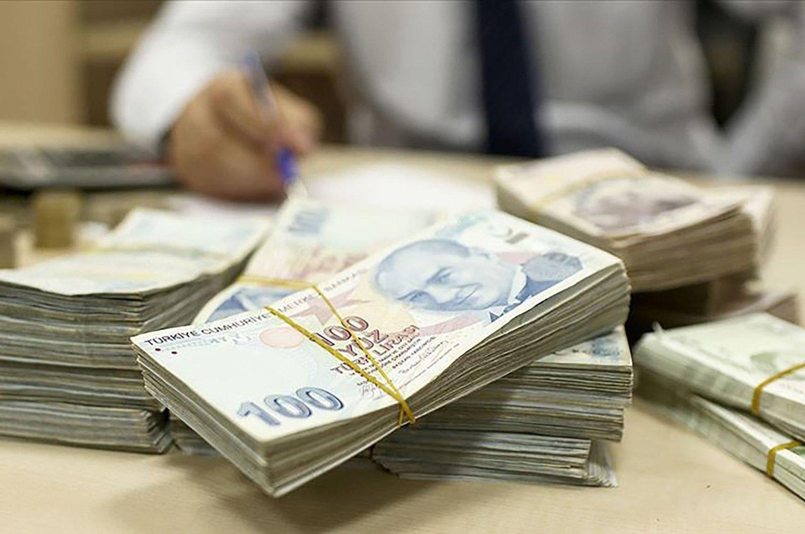 This Sabah file photo shows stacks of Turkish lira.