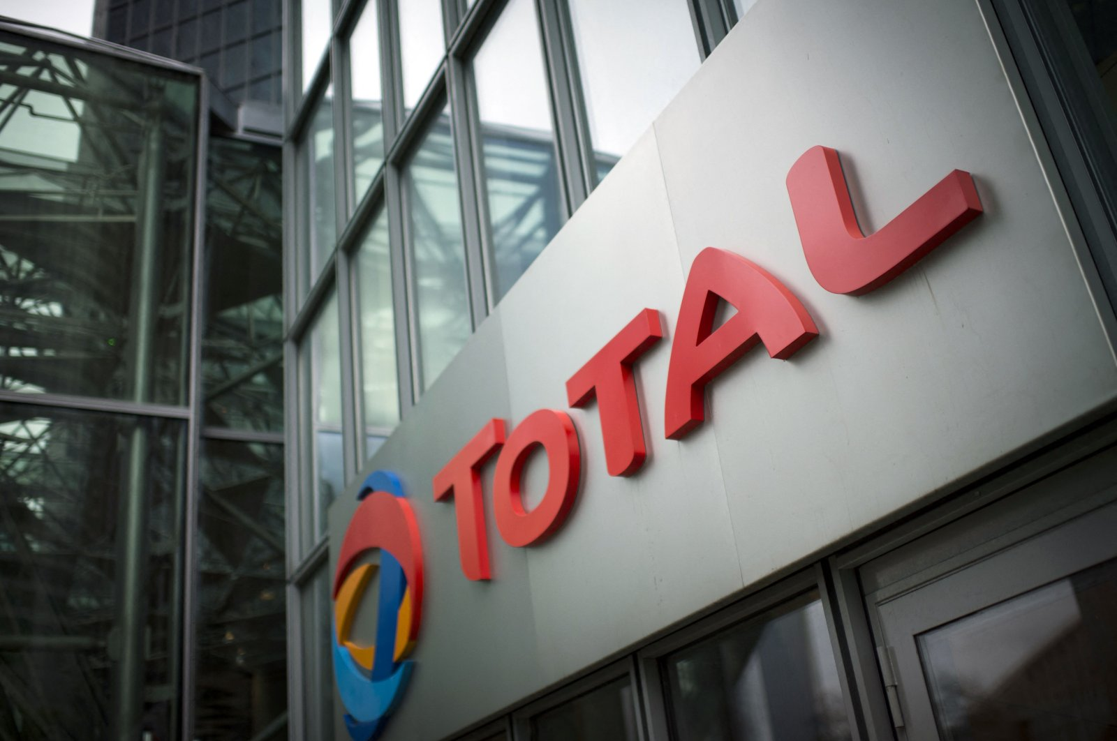 This file photo shows the logo of French oil company headquarters Total in La Defense business district on the outskirts of Paris, France, Oct. 21, 2014.  (AFP Photo)