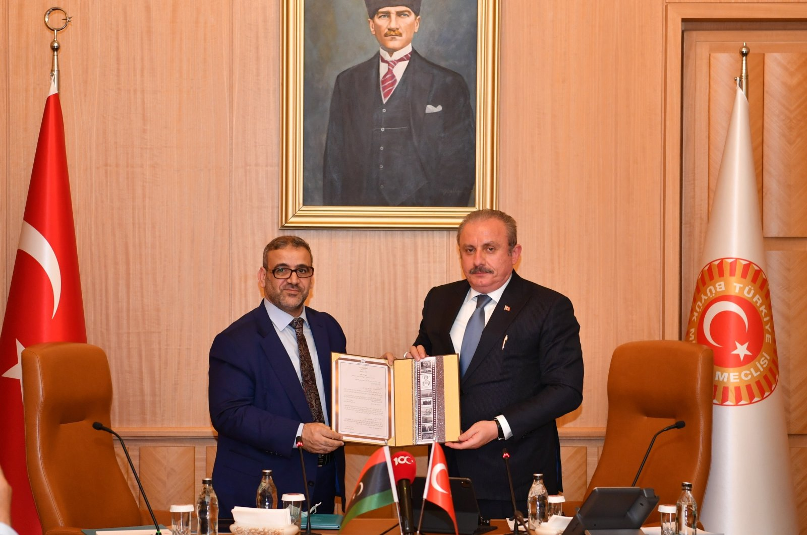 Turkey's Parliament Speaker Mustafa Şentop (R) receives the chairperson of the Libyan High Council of State, Khalid al-Mishri, and his delegation in the Turkish capital, Ankara, Turkey, May 28, 2021. (AA Photo)