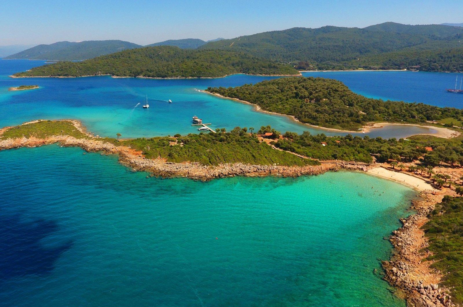 Blue and aqua seawater surrounds Sedir Island – also known as Cleopatra Island– in Gökova, Marmaris, Muğla province, southwestern Turkey. (Shutterstock Photo)