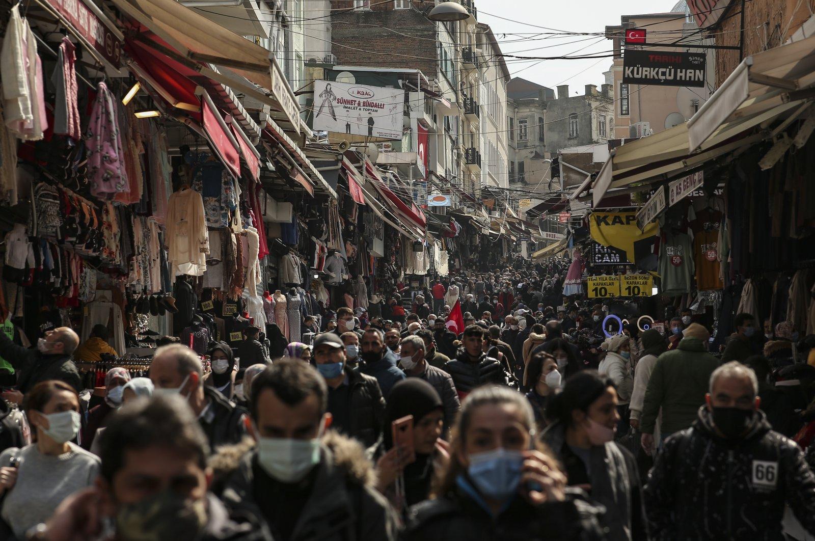 People walk in an open market in Istanbul, Turkey, March 22, 2021. (AP Photo)