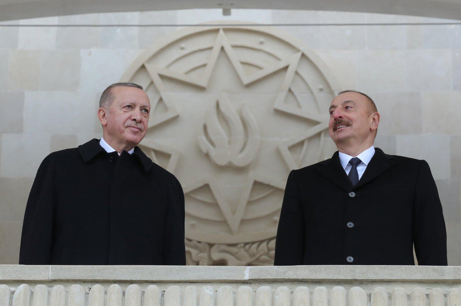 President Recep Tayyip Erdoğan (L) with Azerbaijani President Ilham Aliyev stand together in Baku, Azerbaijan, Dec. 11, 2020. (AA Photo)