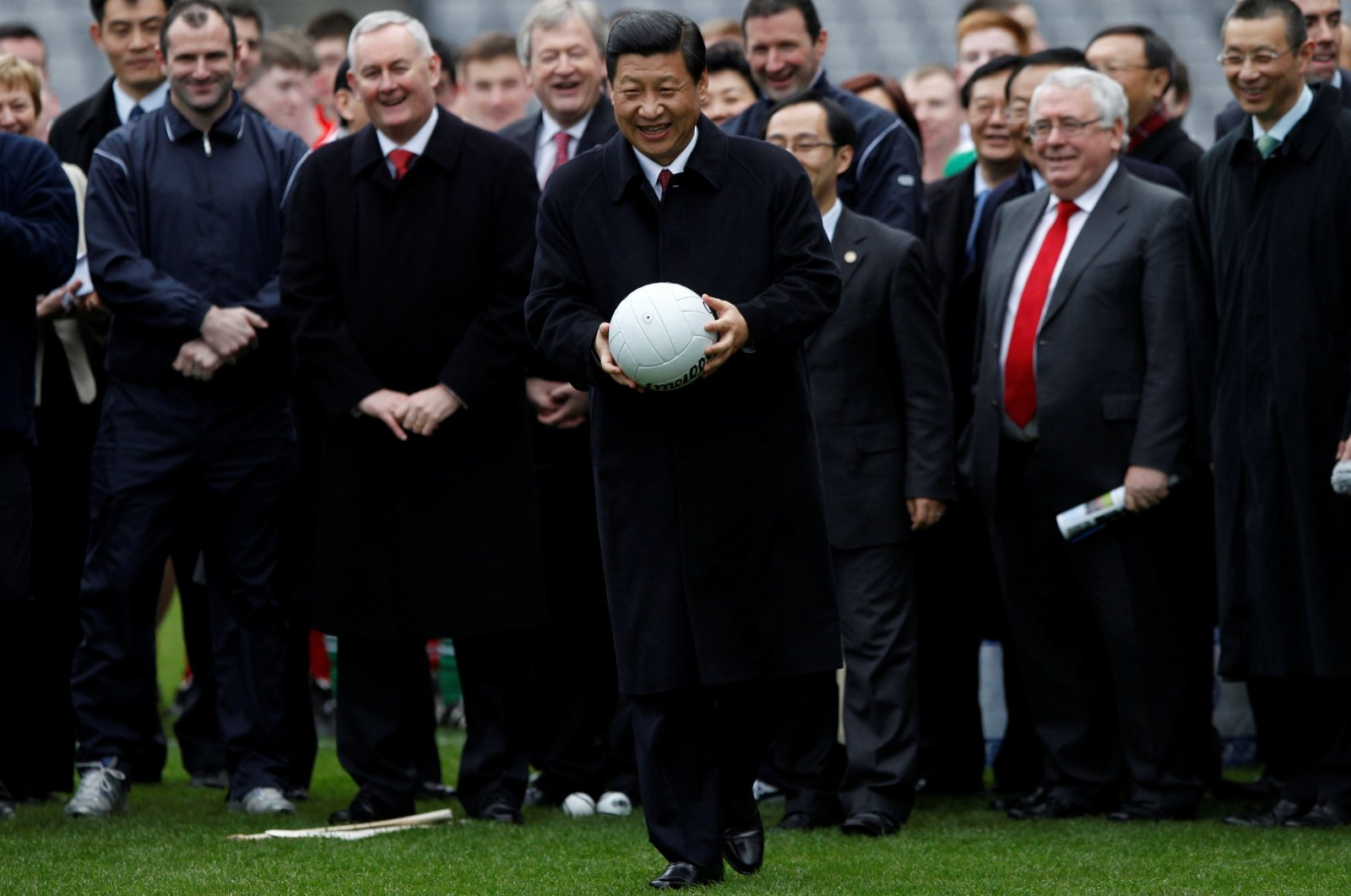 China's Vice-President Xi Jinping holds a football during a visit to Croke Park in Dublin, Ireland, Feb. 19, 2012. (Reuters Photo)