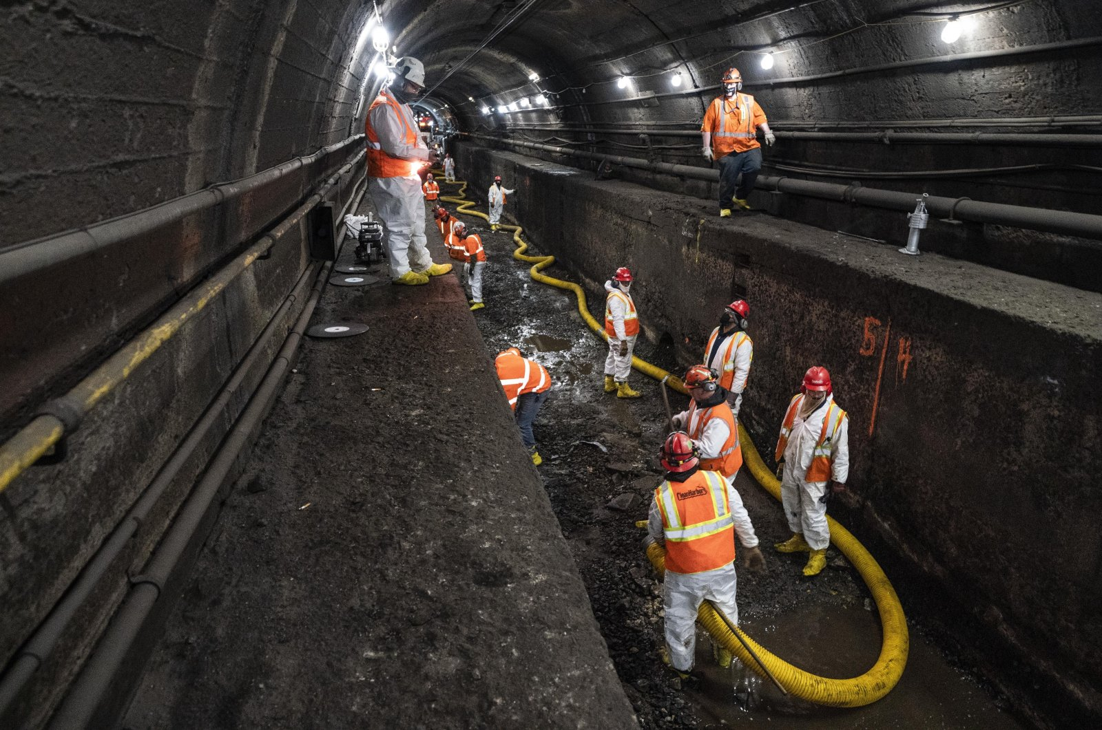 Amtrak workers perform tunnel repairs to a partially flooded train track bed, Weehawken, N.J., the U.S., March 20, 2021. (AP Photo / John Minchillo)