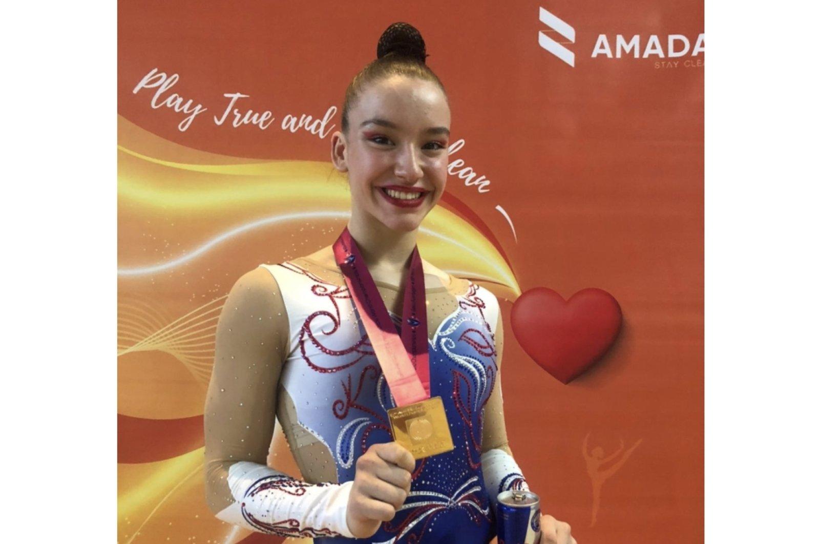 Turkish gymnast Ayşe Begüm Onbaşı posing with her gold medal won at the 16th FIG Aerobic Gymnastics World Championships in Baku, Azerbaijan, May 28, 2021. (Photo by RedBull via AA)