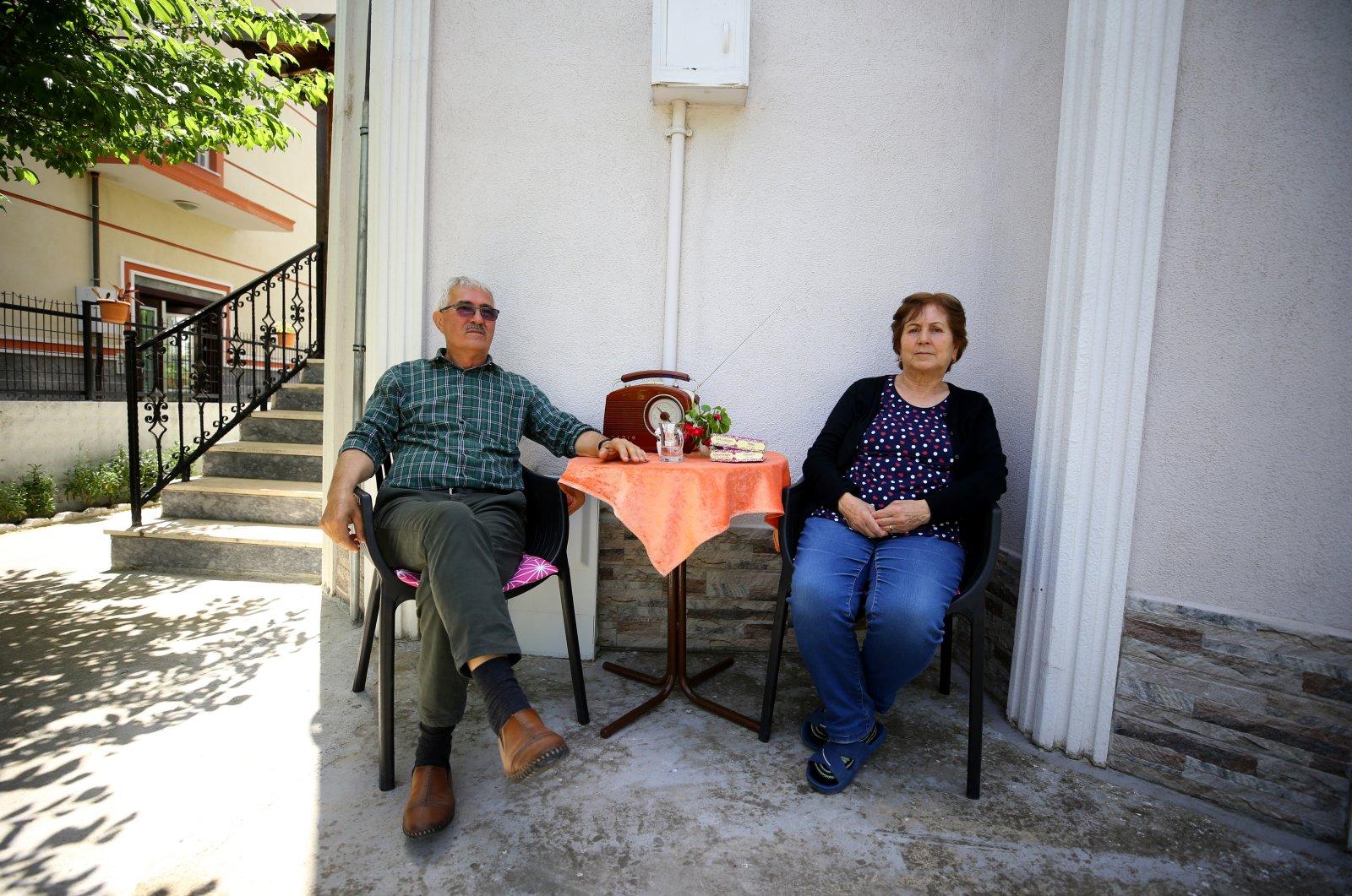 Cemil, 73, and Kıymet Birtane, 70, sit in their garden in Kırklareli province bordering Bulgaria, Edirne, Turkey, May 28, 2021. (Özgün Tiran / Anadolu Agency)