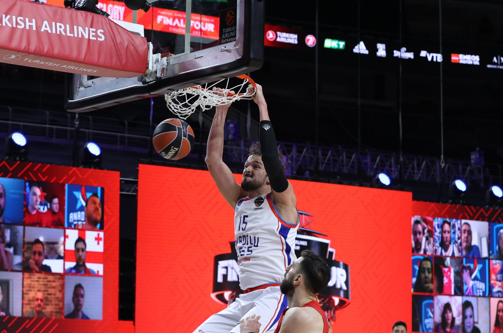 Anadolu Efes' Sertaç Şanlı dunks during the match against CSKA Moscow at the Lanxess Arena in Germany's Cologne on May 28, 2021 (AA Photo)