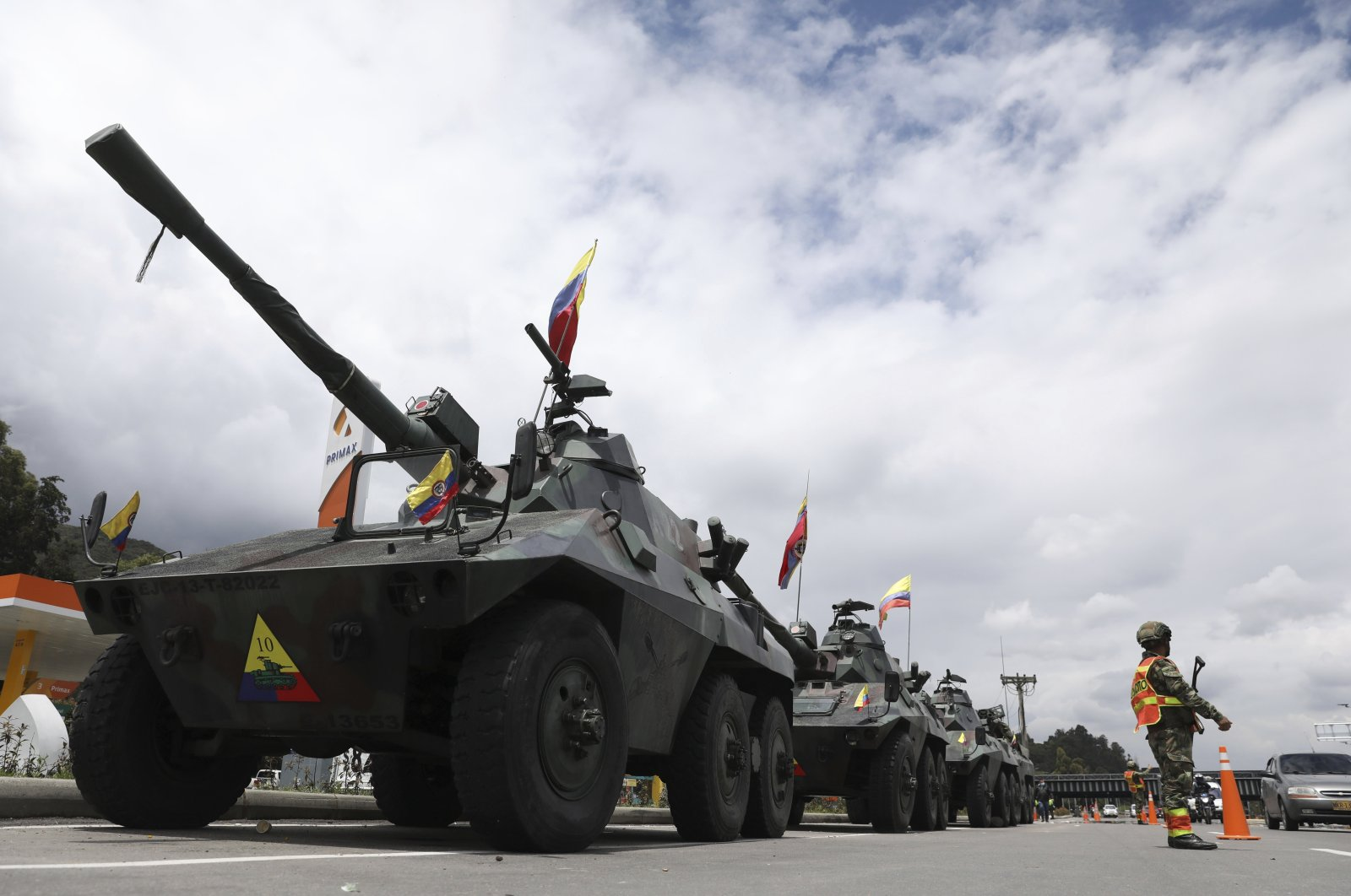 Soldiers and army tanks guard toll booths to keep protesters from damaging them, on the outskirts of Bogota, Colombia, May 4, 2021. (AP Photo)