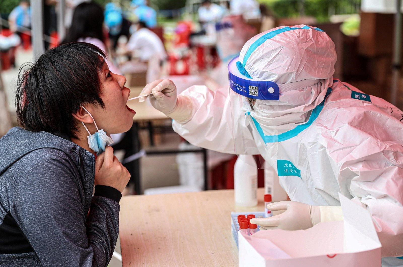 A health worker takes a swab sample from a resident to test for COVID-19 in Shenyang, Liaoning province, northeastern China, May 20, 2021. (AFP Photo)