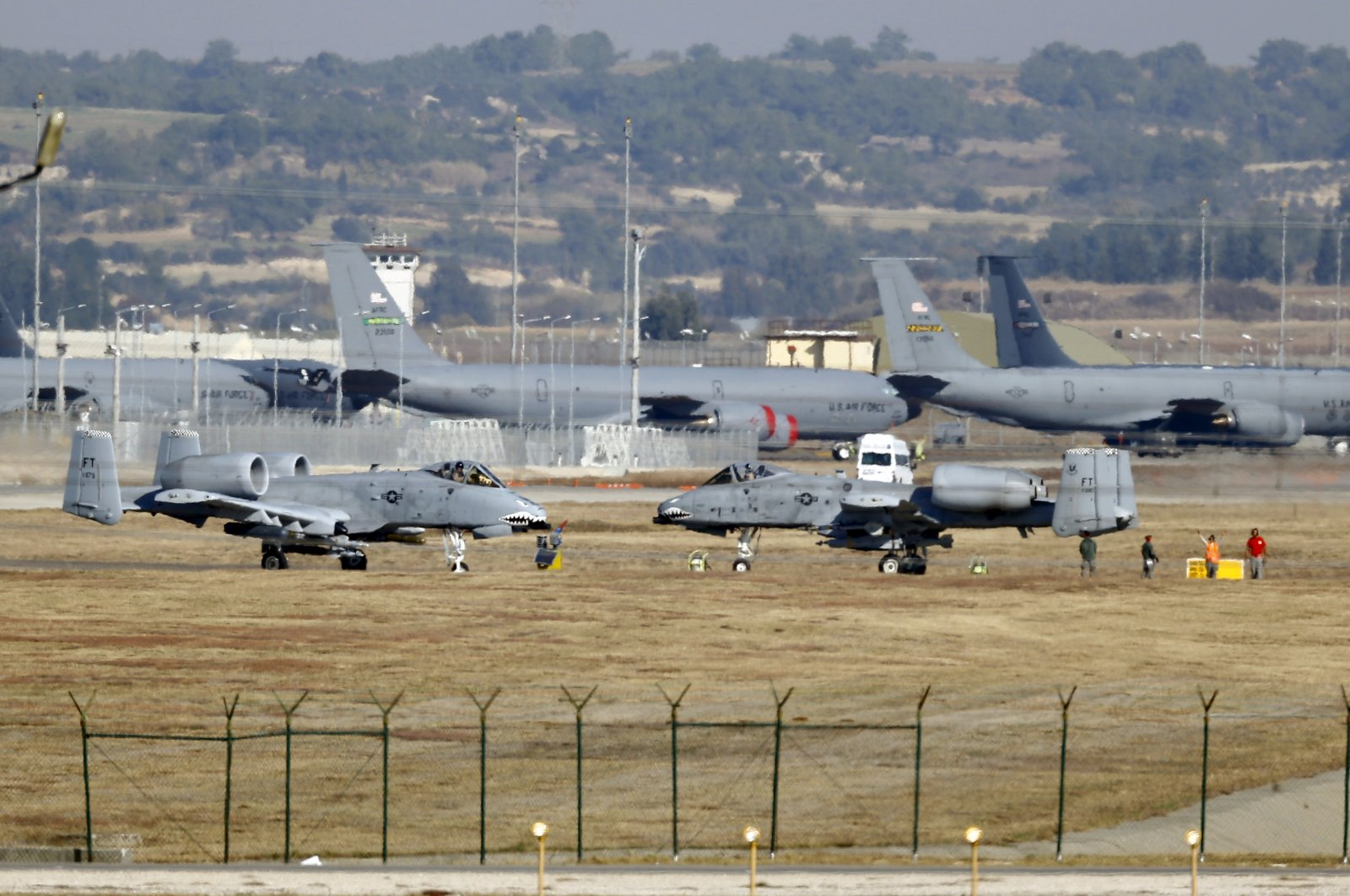 Two U.S. Air Force A-10 Thunderbolt II fighter jets (foreground) sit at the Incirlik Air Base in Adana, southern Turkey, Dec. 11, 2015. (Reuters Photo)