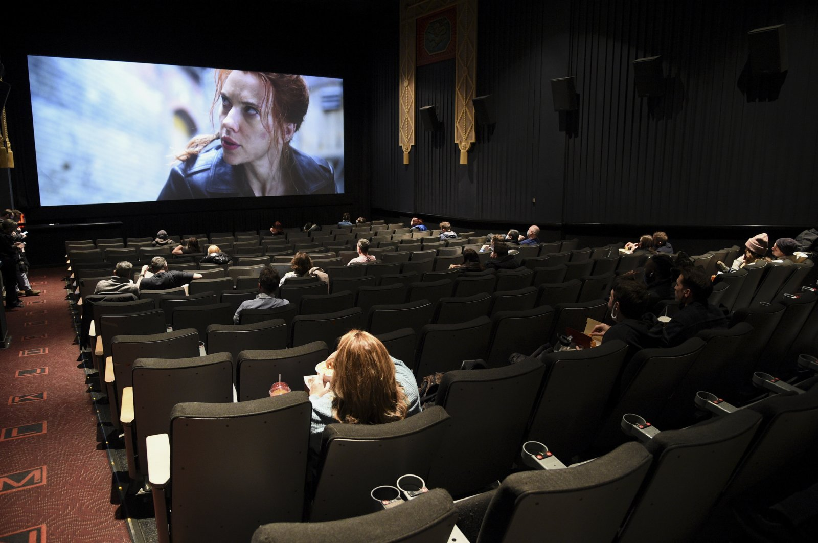 Moviegoers sit in a socially distant seating arrangement at the AMC Lincoln Square 13 theater on the first day of reopened theaters in New York City, New York, U.S., March 5, 2021. (Photo by Evan Agostini/Invision/AP, File)