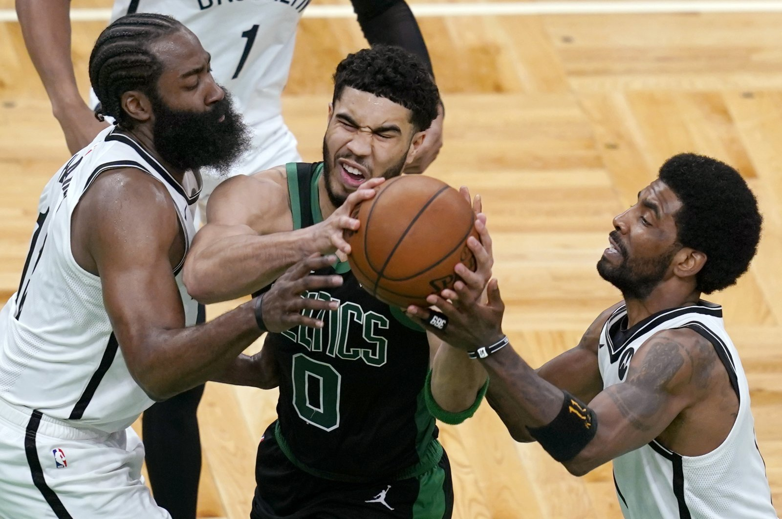 Boston Celtics forward Jayson Tatum (0) drives between Brooklyn Nets guards James Harden (L) and Kyrie Irving during the fourth quarter in Game 3 of an NBA basketball first-round playoff series Friday, May 28, 2021, in Boston. (AP Photo)