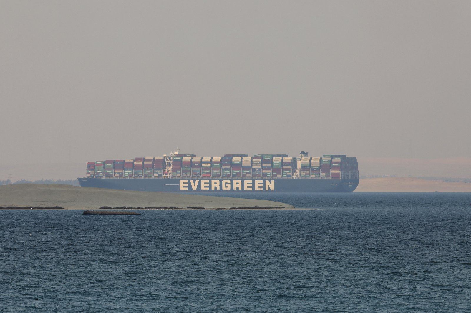 The Ever Given, a Panama-flagged cargo ship, is anchored in Egypt's Great Bitter Lake, March 30, 2021  (AP Photo/Mohamed El-shahed, File)