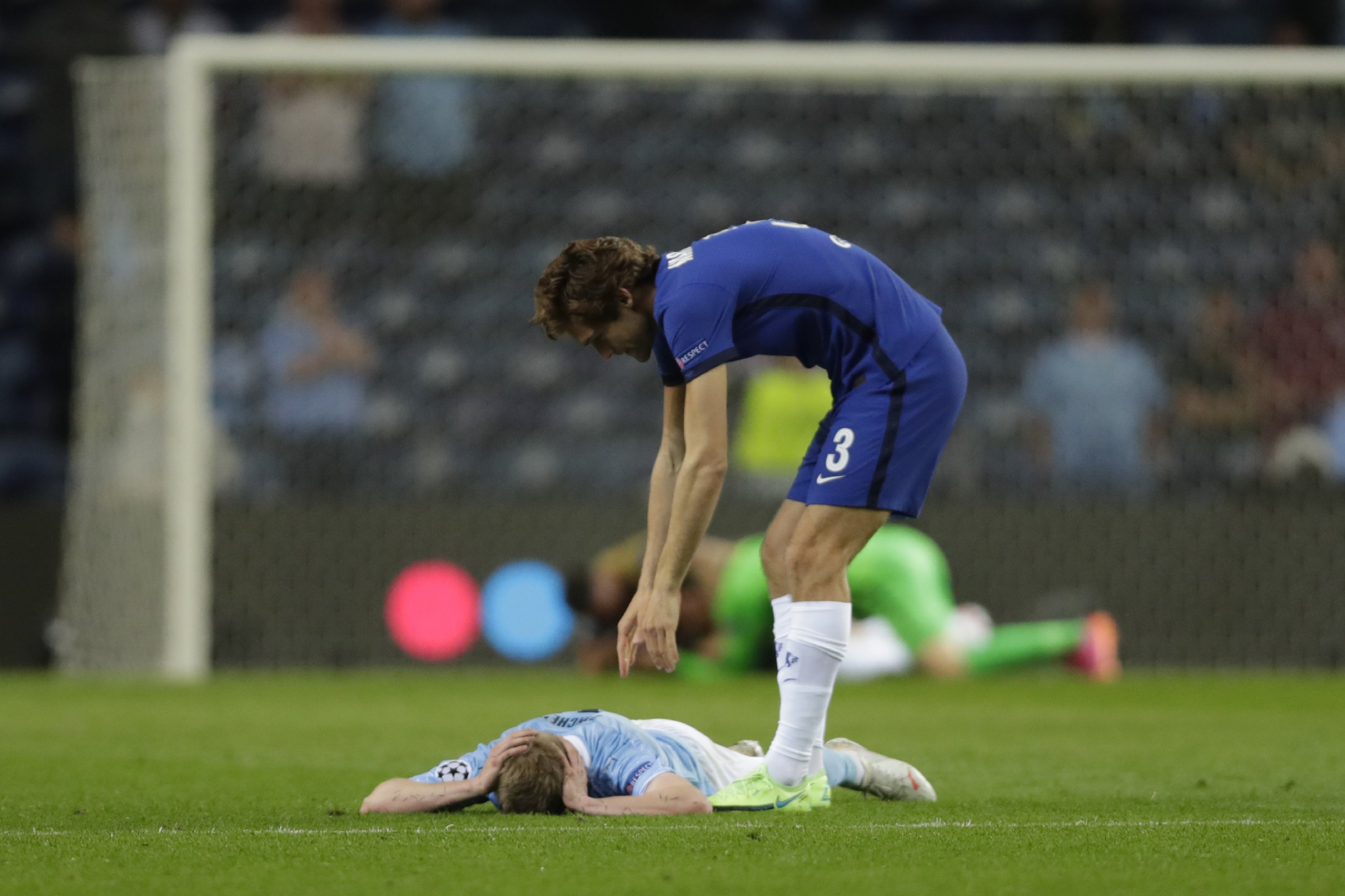 Manchester City's Oleksandr Zinchenko (L) is comforted by Chelsea's Marcos Alonso after Chelsea won the Champions League title at Dragao Stadium in Porto, Portugal, May 29, 2021. (AP Photo)