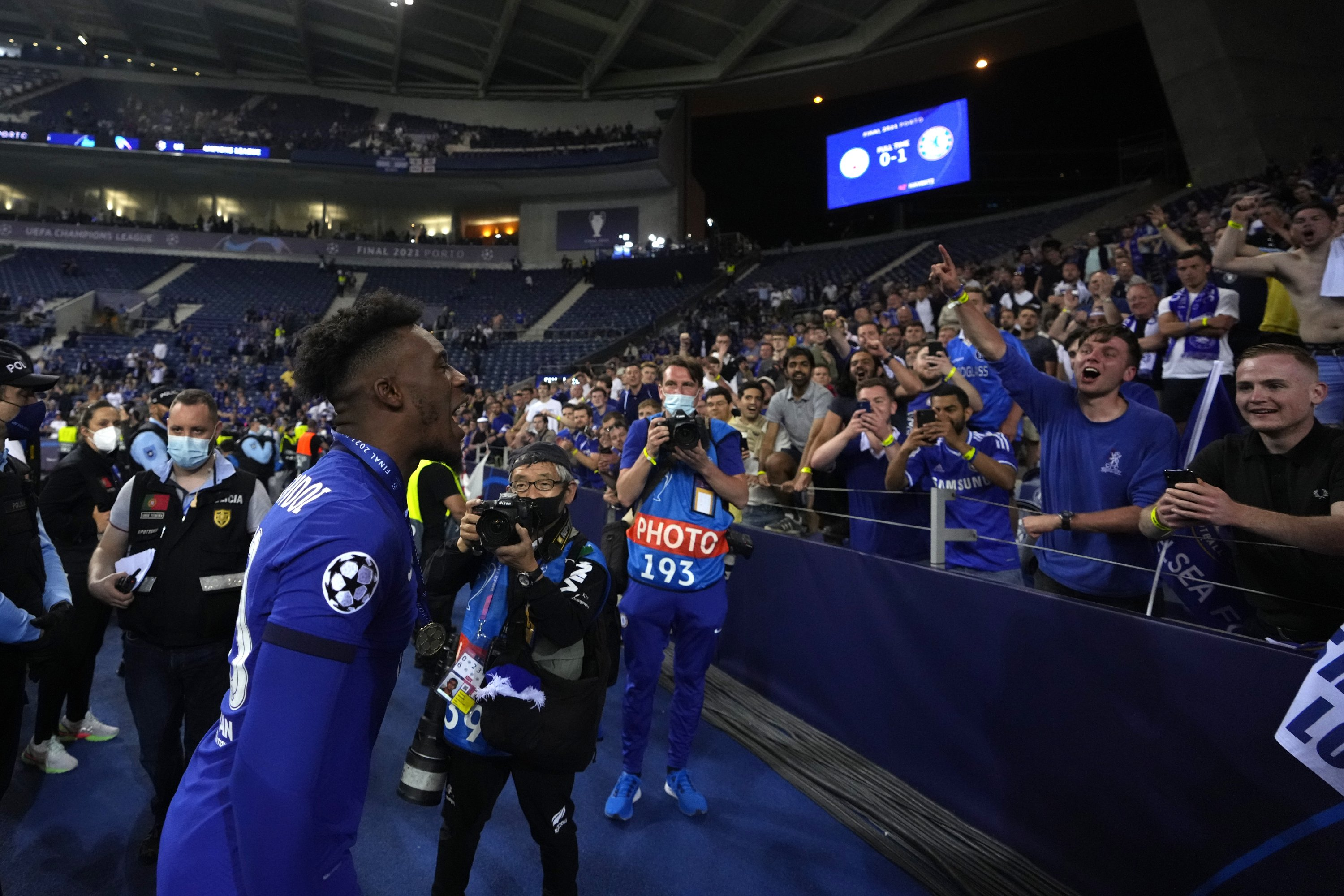 Chelsea's Callum Hudson-Odoi celebrates with fans after winning the Champions League final match against Manchester City at Dragao Stadium in Porto, Portugal, May 29, 2021. (AP Photo)