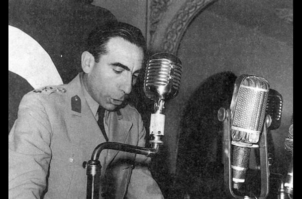 An archive photo showing Col. Alparslan Türkeş reading the declaration of the coup on May 27, 1960.