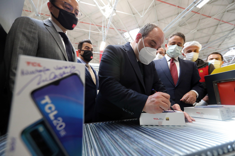 Industry and Technology Minister Mustafa Varank signs a mobile phone produced in the TCL-Arçelik joint facility in Çerkezköy OIZ, Tekirdağ, northwestern Turkey, May 30, 2021. (AA Photo)