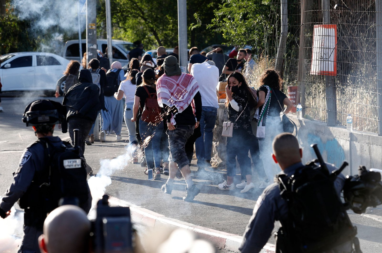 Israeli security forces fire tear gas toward Palestinian protesters and activists near an Israeli Police checkpoint at the entrance of the Sheikh Jarrah neighbourhood in East Jerusalem, occupied Palestine, May 29, 2021. (AFP Photo)