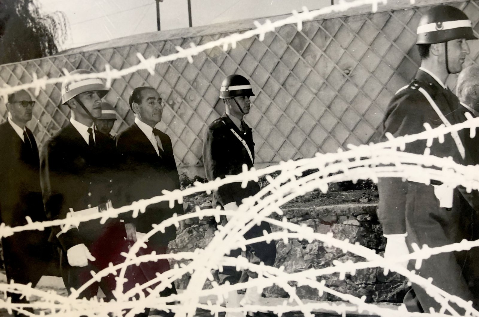 An archive photo showing then-Prime Minister Adnan Menderes behind fences accompanied by coup soldiers on Yassıada Island, Istanbul, Turkey, May 1960. (AA Photo)
