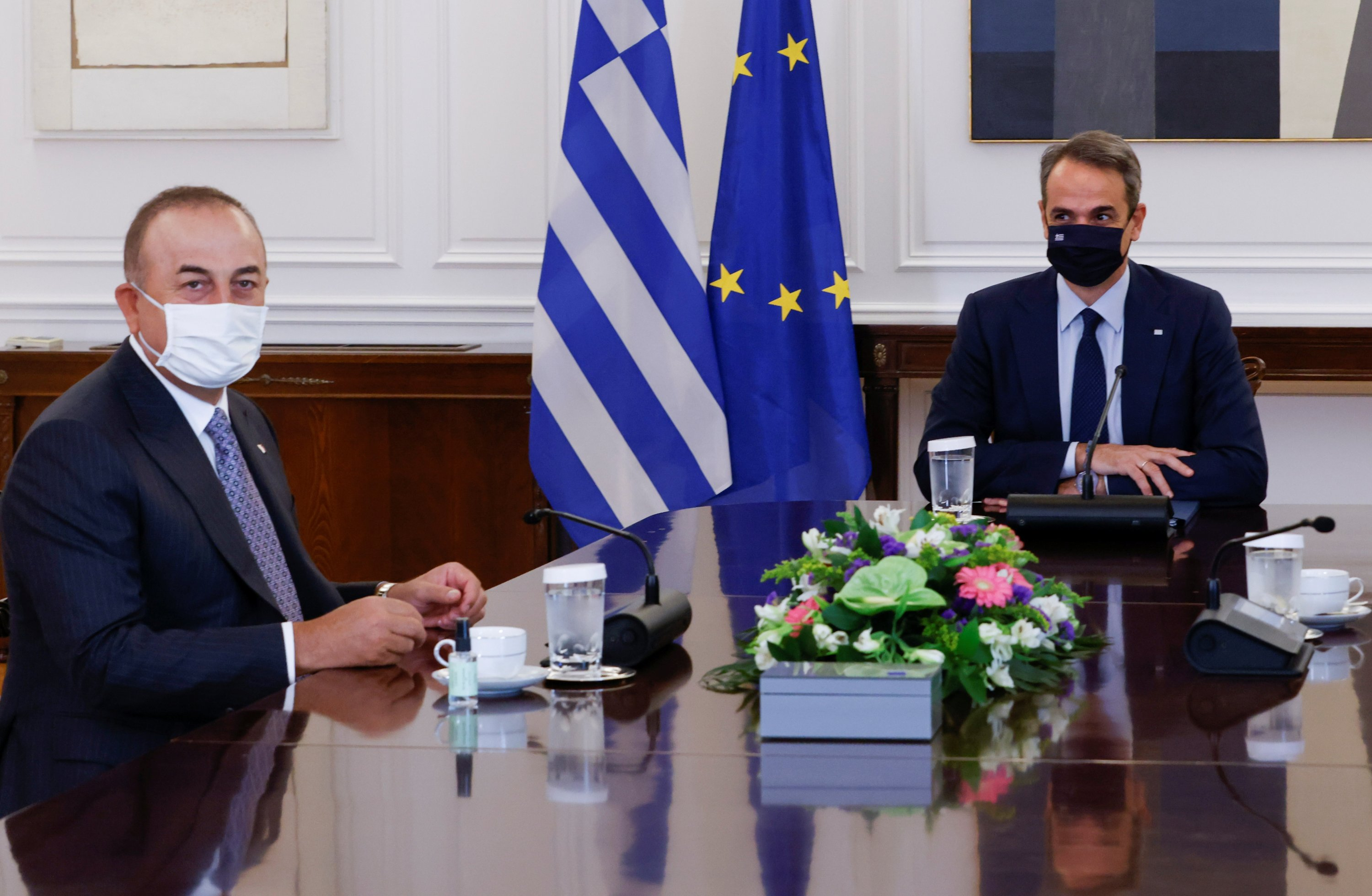 Greek Prime Minister Kyriakos Mitsotakis (R) meets with Turkish Foreign Minister Mevlüt Çavuşoğlu at the Maximos Mansion in Athens, Greece, May 31, 2021. (REUTERS Photo)