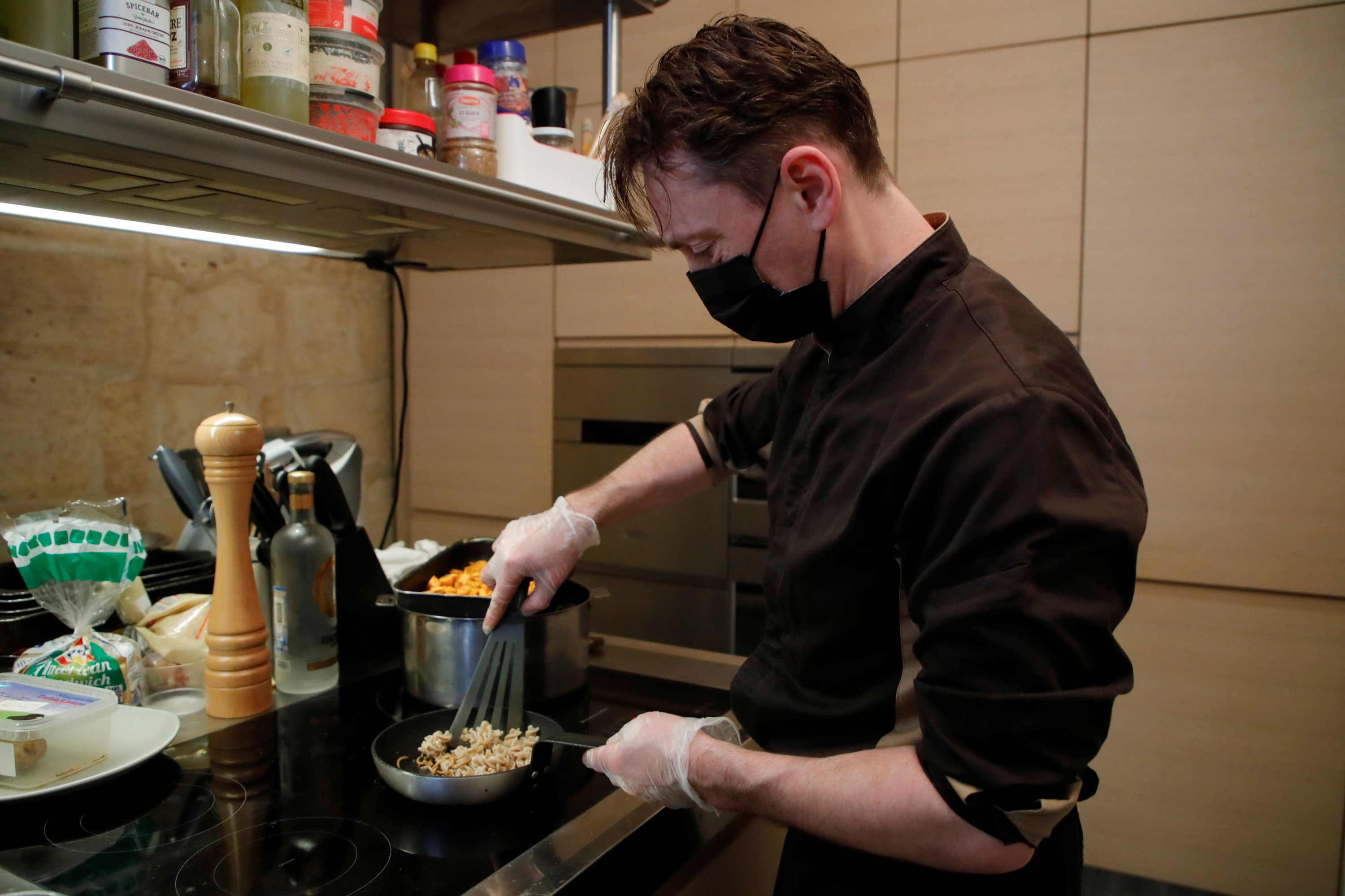 French chef Laurent Veyet prepares a dish with fried mealworms in his restaurant Inoveat serving only insect-based food in Paris, France, May 12, 2021. (Reuters Photo)