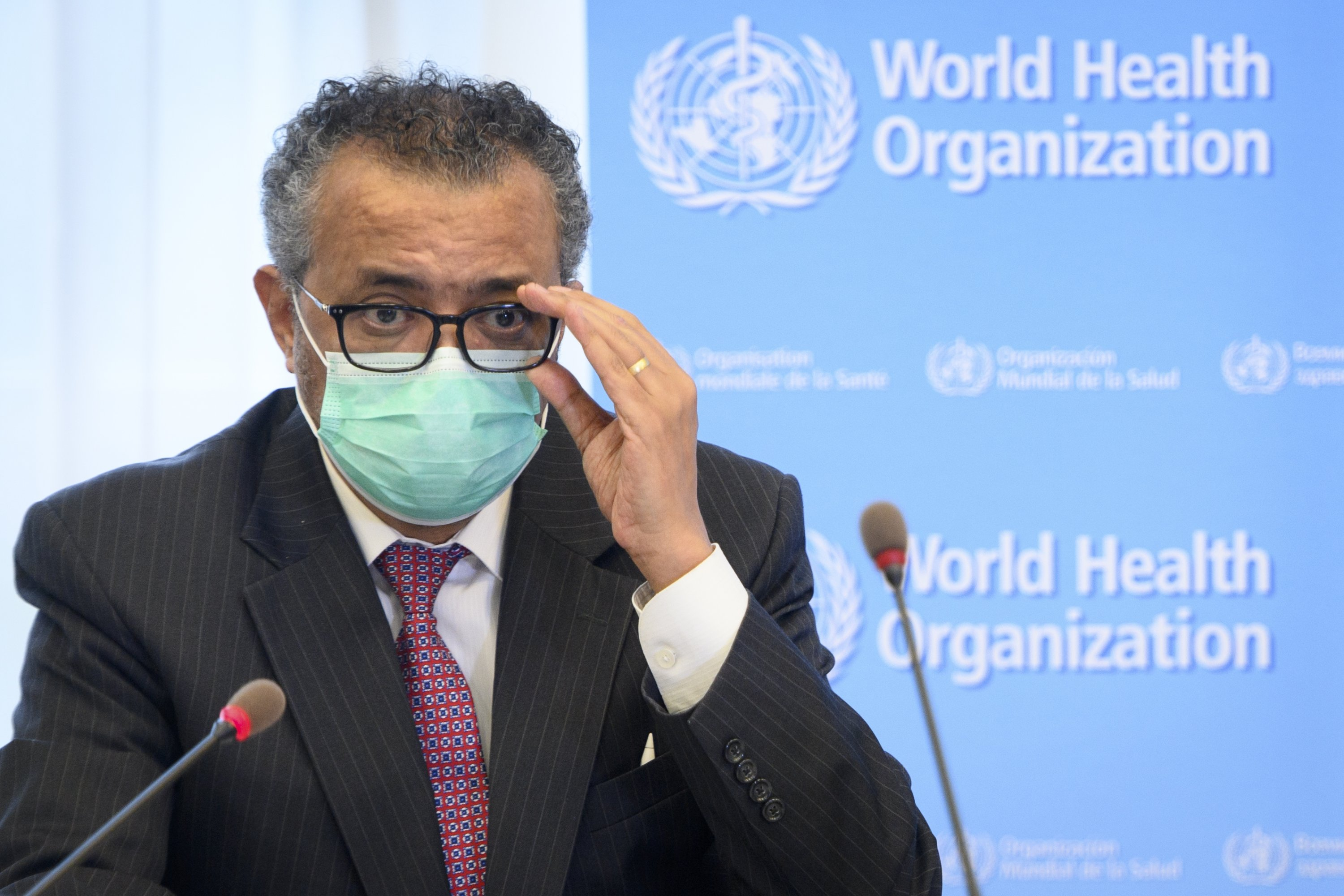 Tedros Adhanom Ghebreyesus, director-general of the World Health Organization (WHO) speaks during a bilateral meeting with Swiss Interior and Health Minister Alain Berset, not pictured, before signing a BioHub Initiative with a global COVID-19 Pathogen repository in Spiez laboratory on the sideline of the opening of the 74th World Health Assembly, WHA, at the WHO headquarters, in Geneva, Switzerland, May 24, 2021. (Laurent Gillieron/Keystone via AP)