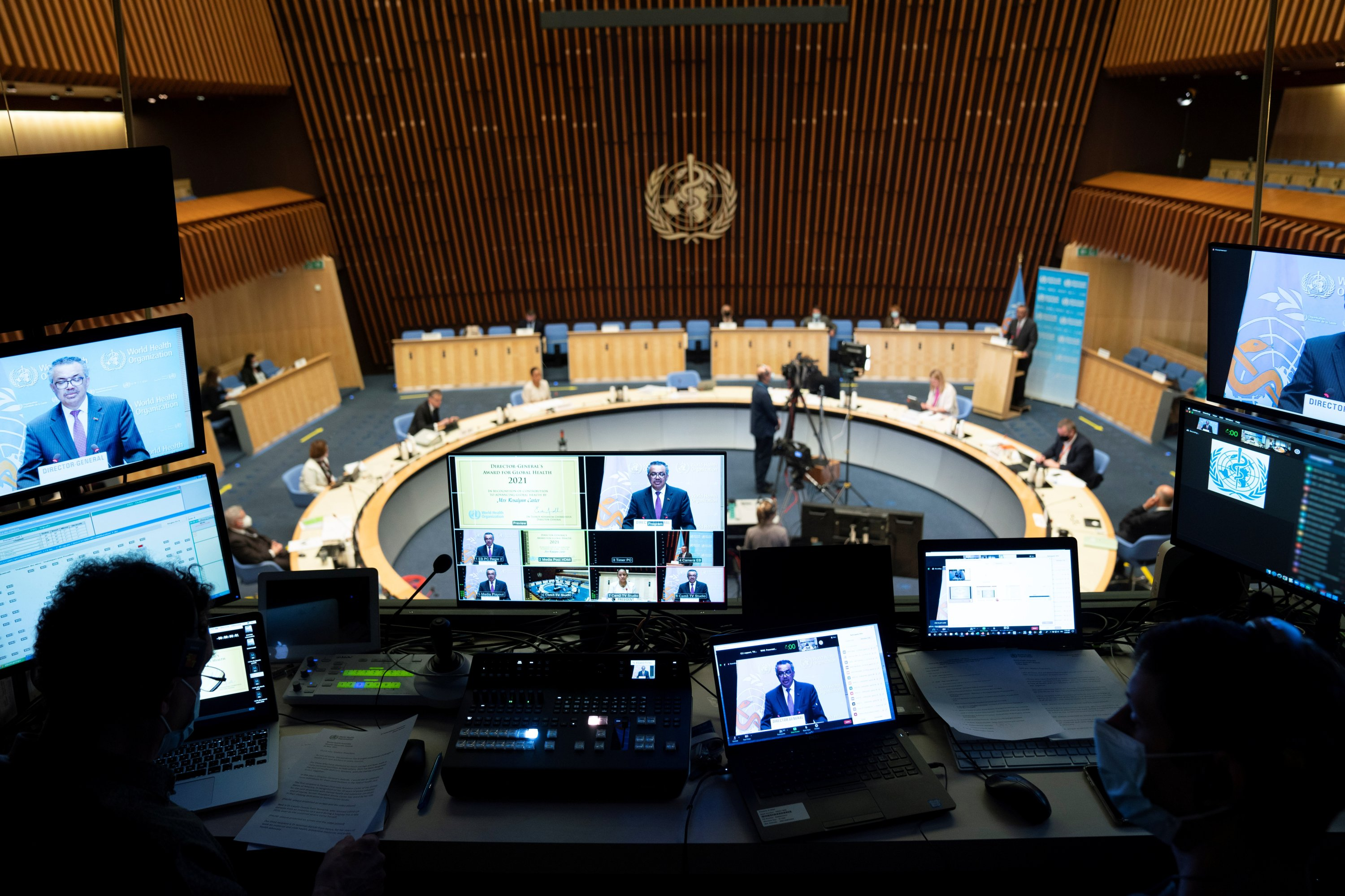 World Health Organization (WHO) Director-General Tedros Adhanom Ghebreyesus is seen on screens as he attends the World Health Assembly (WHA) amid the COVID-19 pandemic in Geneva, Switzerland, May 24, 2021. (Christopher Black/World Health Organization/Handout via Reuters)