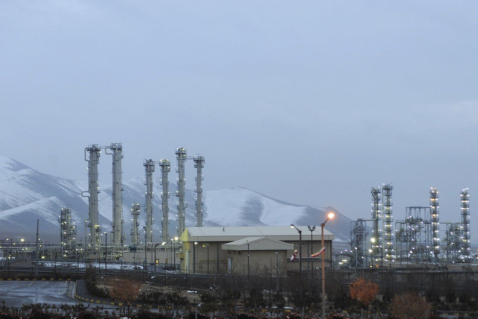 Lights speckle the Arak heavy-water nuclear facilities, near the central city of Arak, 150 miles (250 kilometers) southwest of the capital Tehran, Iran, Jan. 15, 2011. (AP Photo/ISNA, Hamid Foroutan, File)