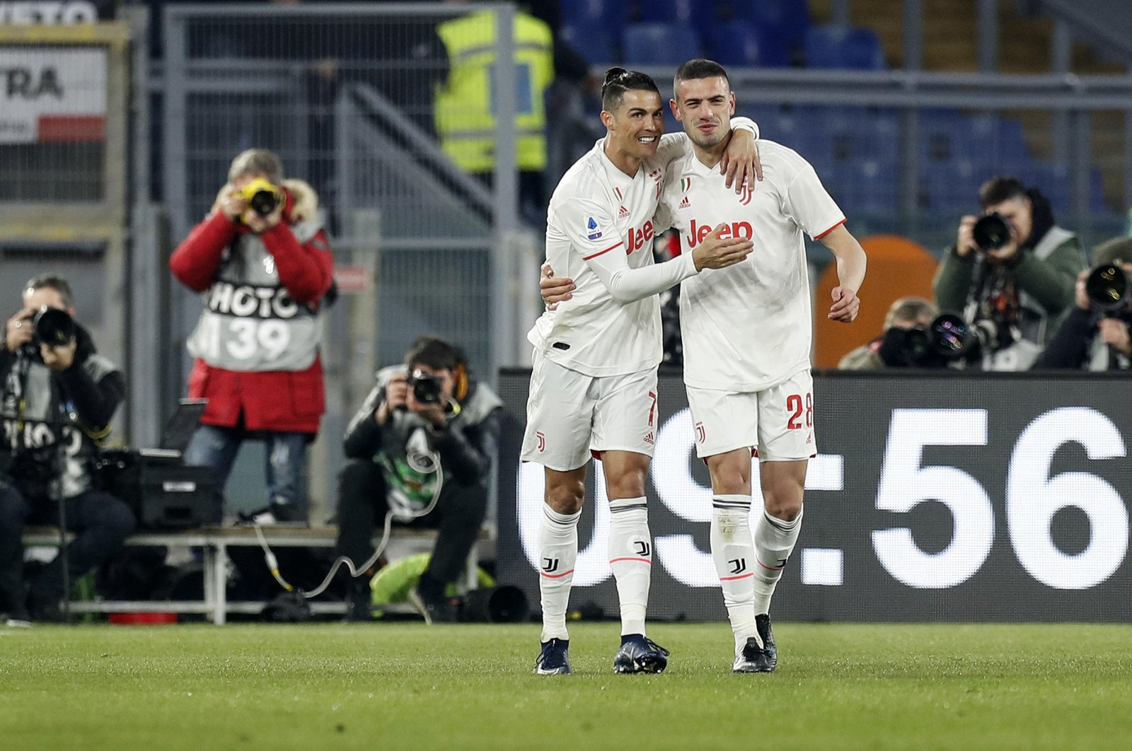 Juventus striker Cristiano Ronaldo (L) celebrates his goal with Merih Demiral during the Serie A soccer match between Roma and Juventus at Olimpico Stadium in Rome, Italy, Jan. 12, 2020. (EPA Photo)