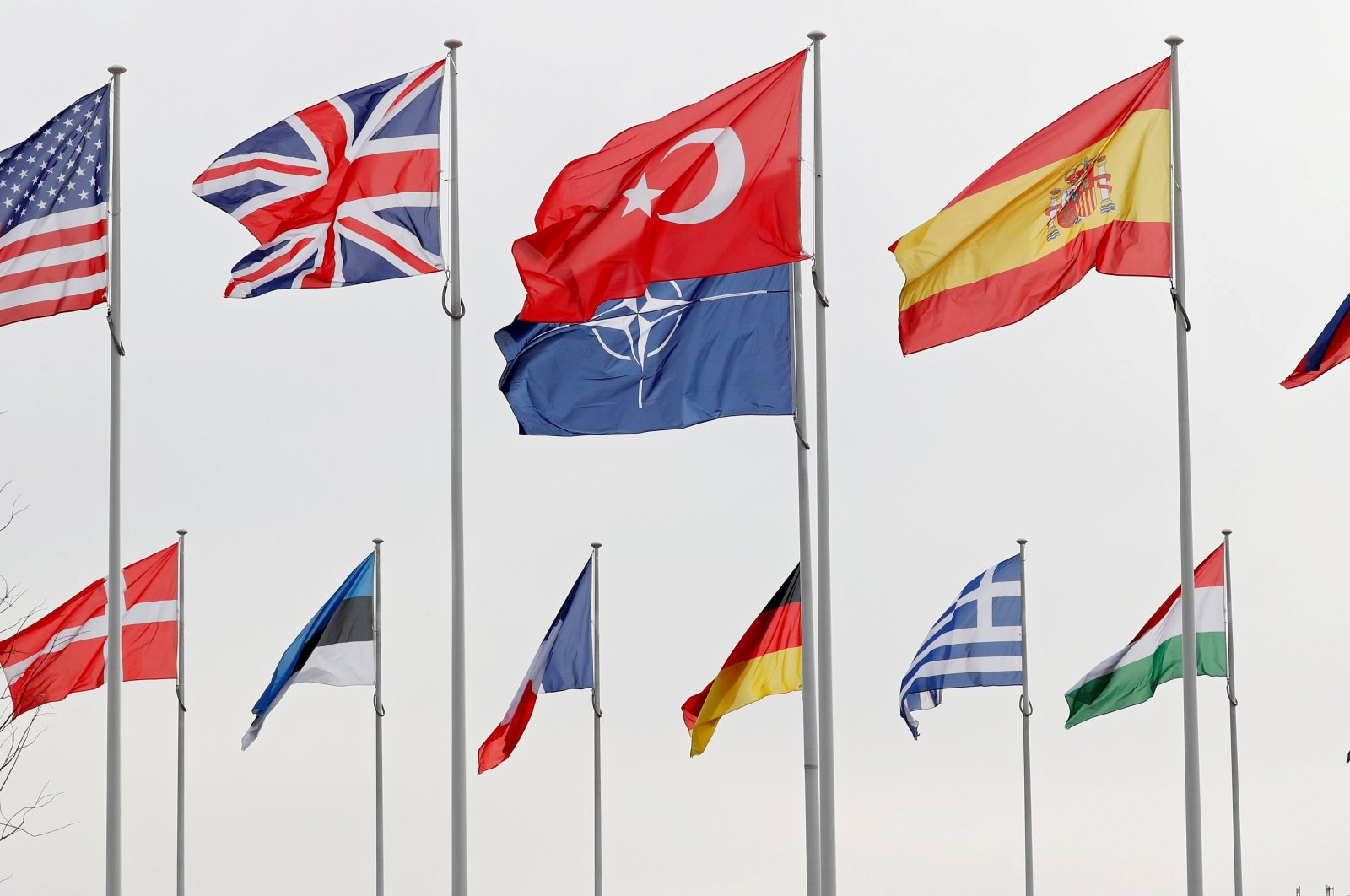 Flags of NATO member countries flutter at alliance headquarters in Brussels, Belgium, Feb. 28, 2020. (Reuters Photo)