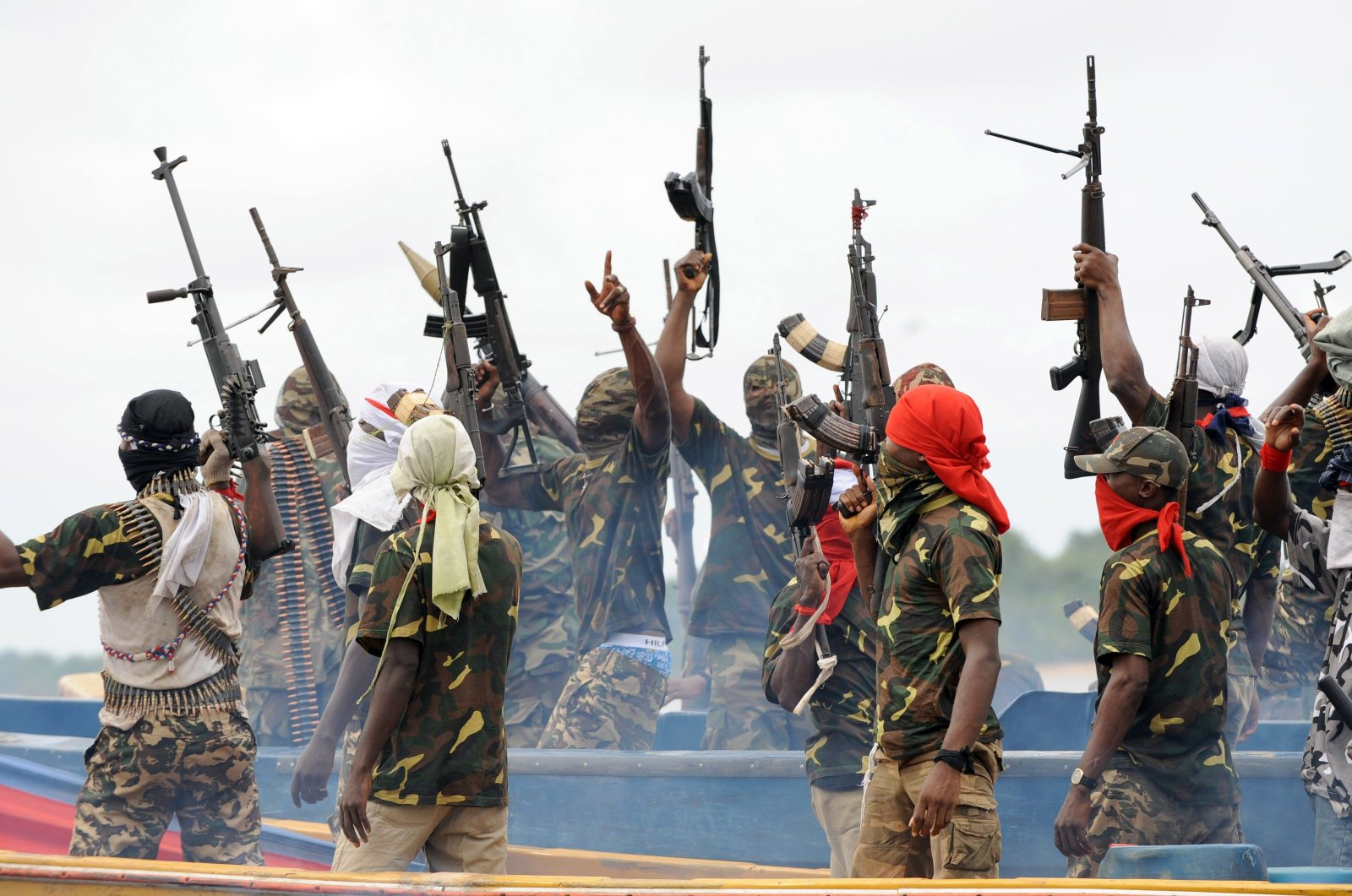 Fighters with the Movement for the Emancipation of the Niger Delta (MEND) raise their rifles to celebrate news of a successful operation by their colleagues against the Nigerian army in the Niger Delta, Sept. 17, 2008. (AFP Photo)