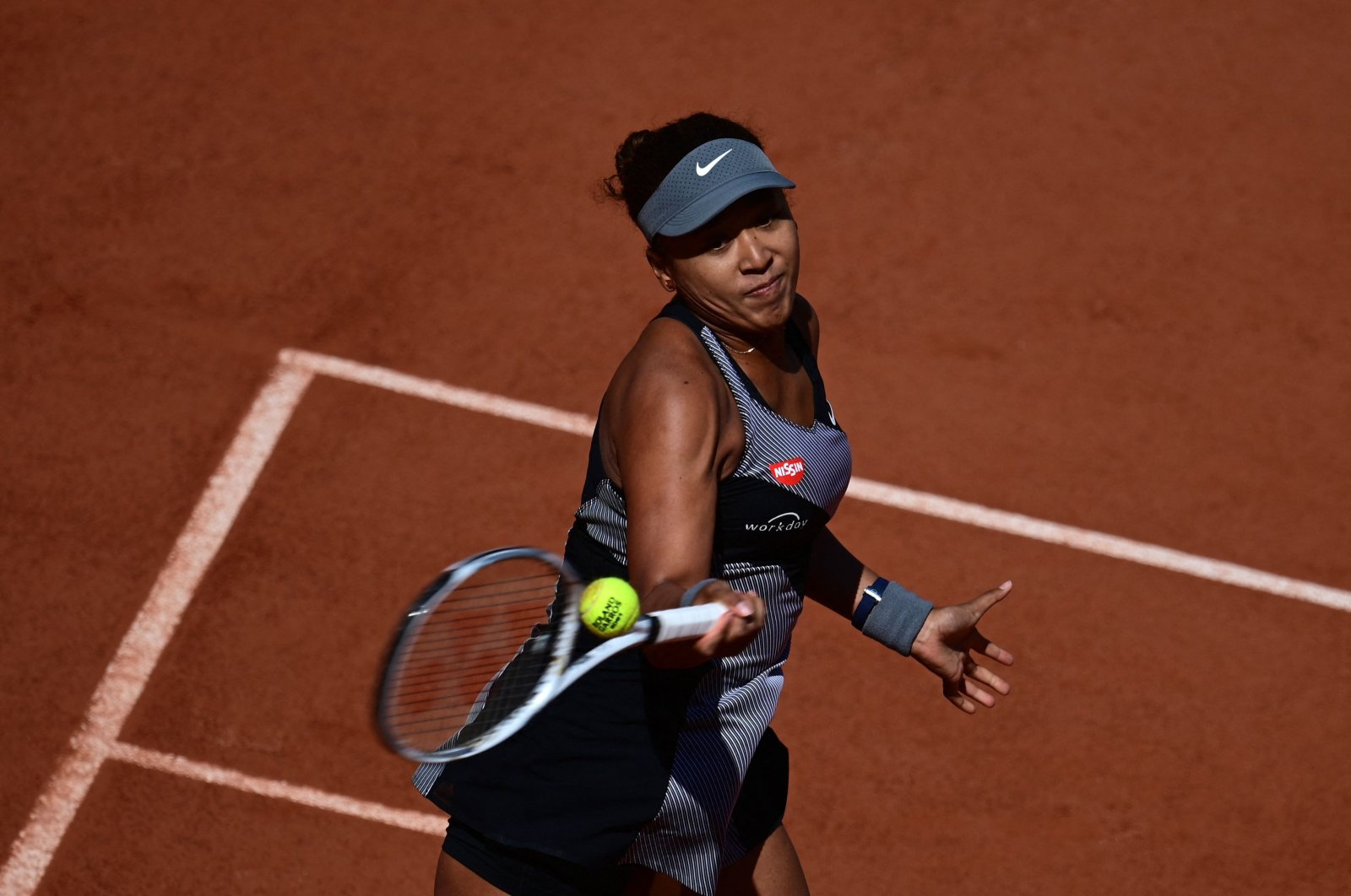 Japan's Naomi Osaka returns the ball to Romania's Patricia Maria Tig during their women's singles first round tennis match on Day 1 of the French Open, Paris, France, May 30, 2021. (AFP Photo)