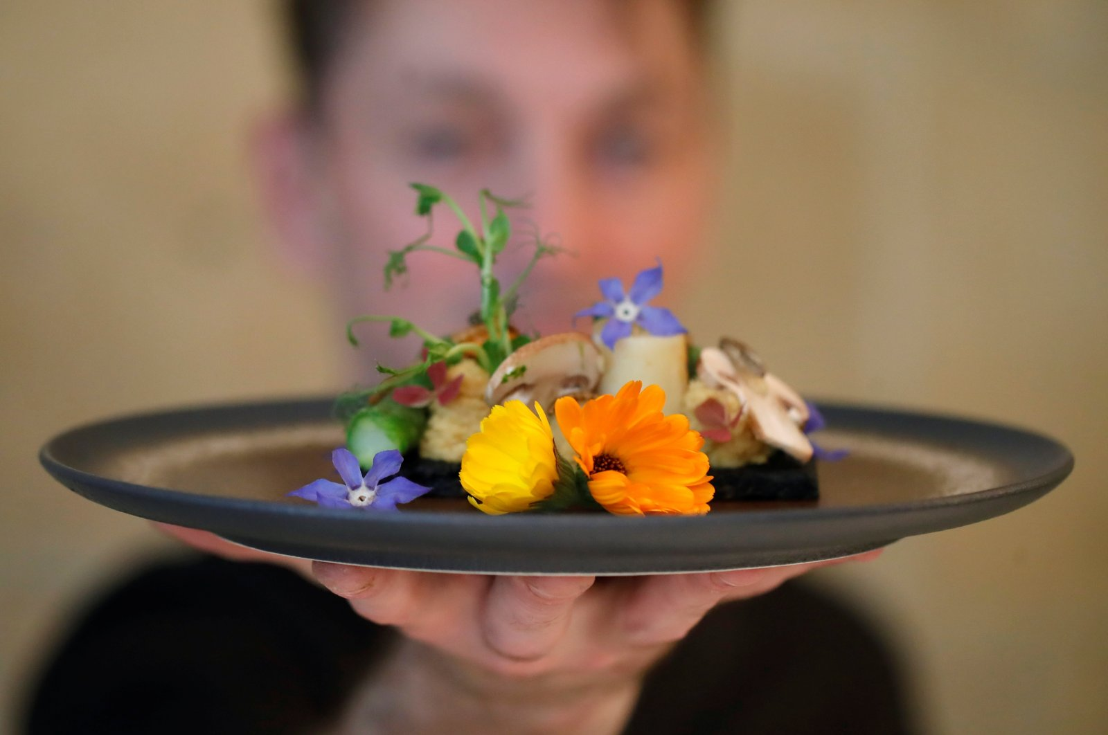 French chef Laurent Veyet displays a dish as he poses in his restaurant Inoveat serving insect-based food in Paris, France, May 12, 2021. (Reuters Photo)