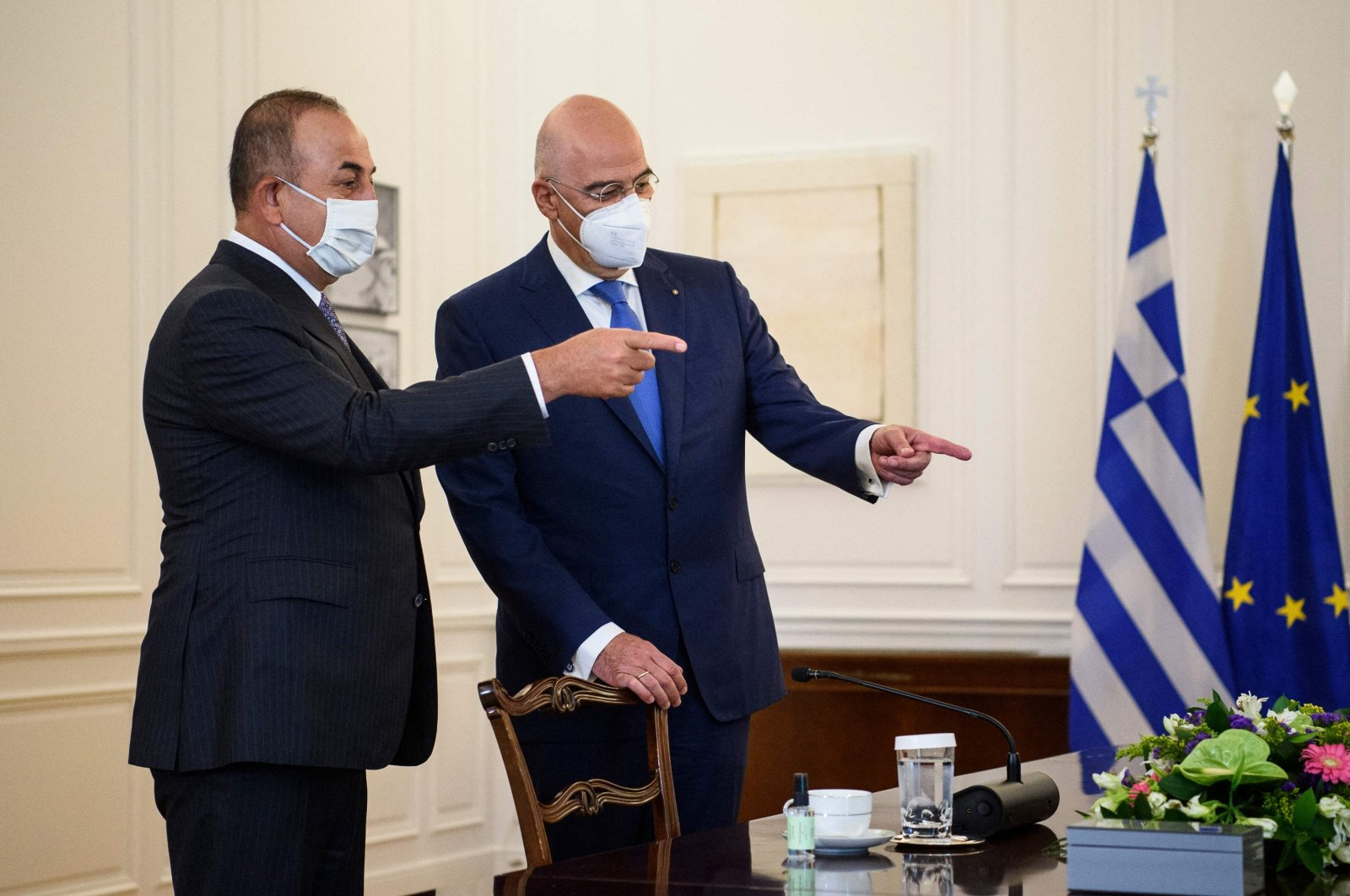 Foreign Minister Mevlüt Çavuşoğlu (L) and Greek Foreign Minister Nikos Dendias speak before their meeting at the Greek Ministry of Foreign Affairs in Athens on May 31, 2021. (AFP Photo)