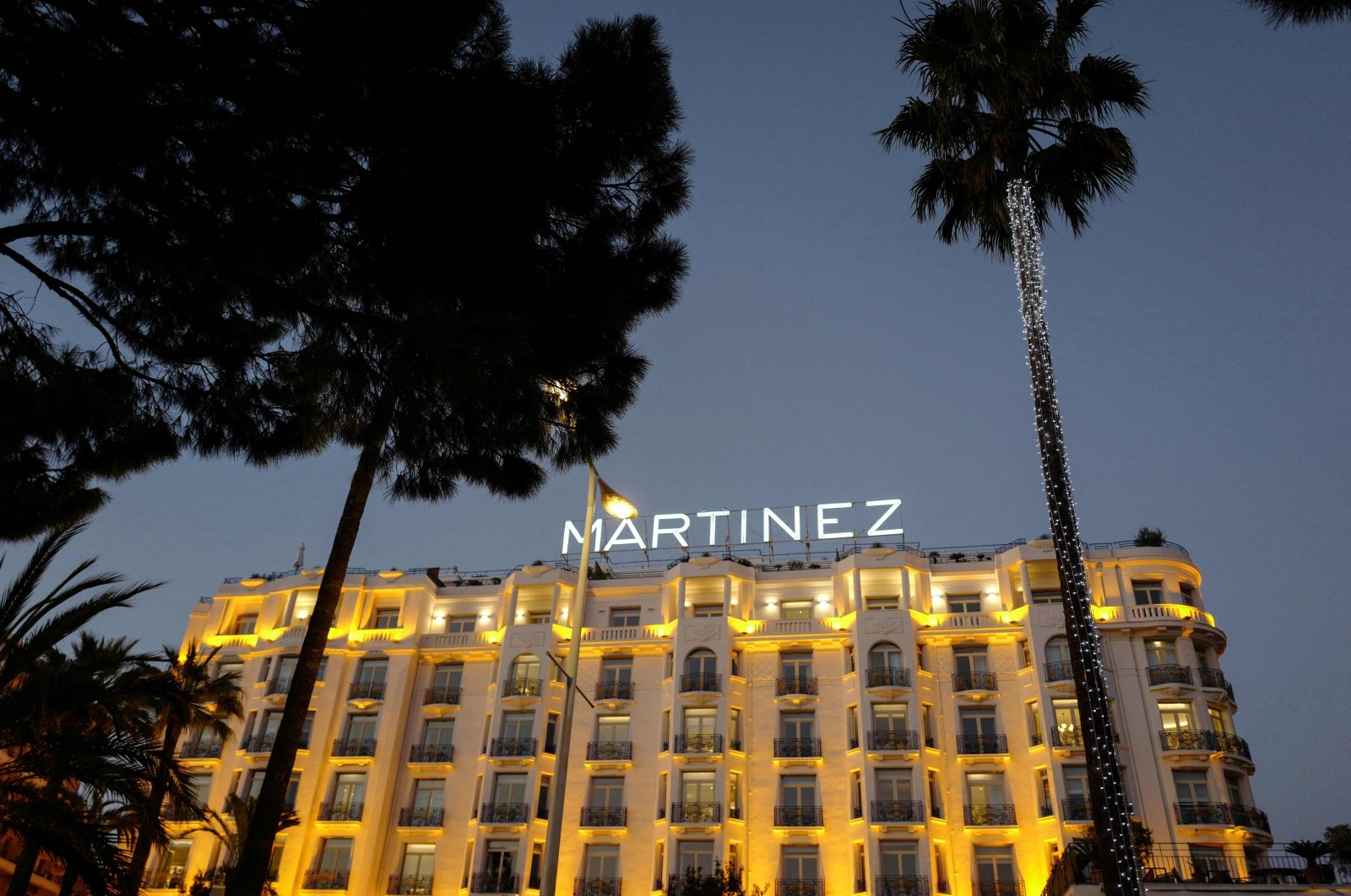 Lights shine upon the Hotel Martinez palace in the evening, on the French riviera city of Cannes, southern France, March 20, 2019. (AFP Photo)