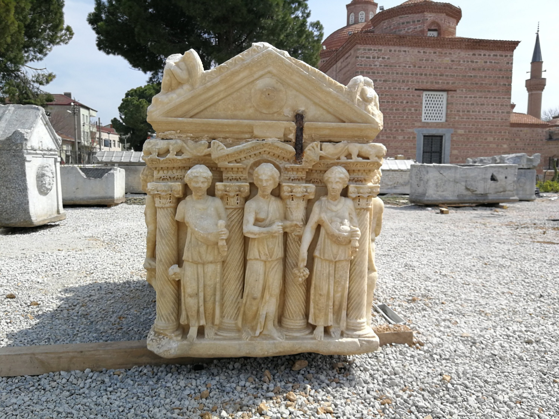 Three female figures stand alongside each other between columns engraved on a sarcophagus, at the Iznik Museum, Bursa, Turkey, June 1, 2021. (IHA Photo)