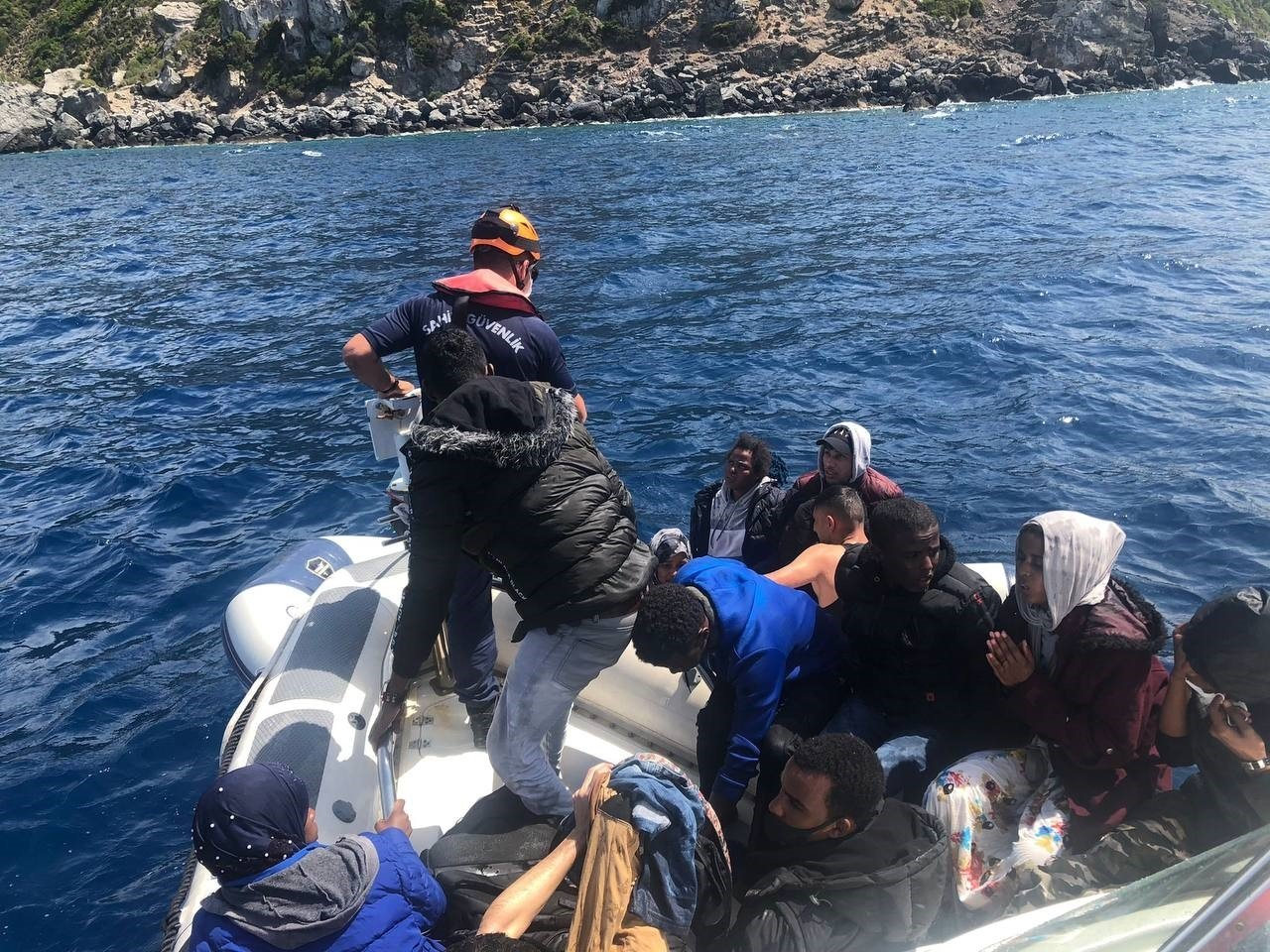 The Turkish coast guard saves asylum-seekers among the 74 they rescued off the coast of Çeşme district in Izmir province, western Turkey, May 31, 2021. (AA Photo)