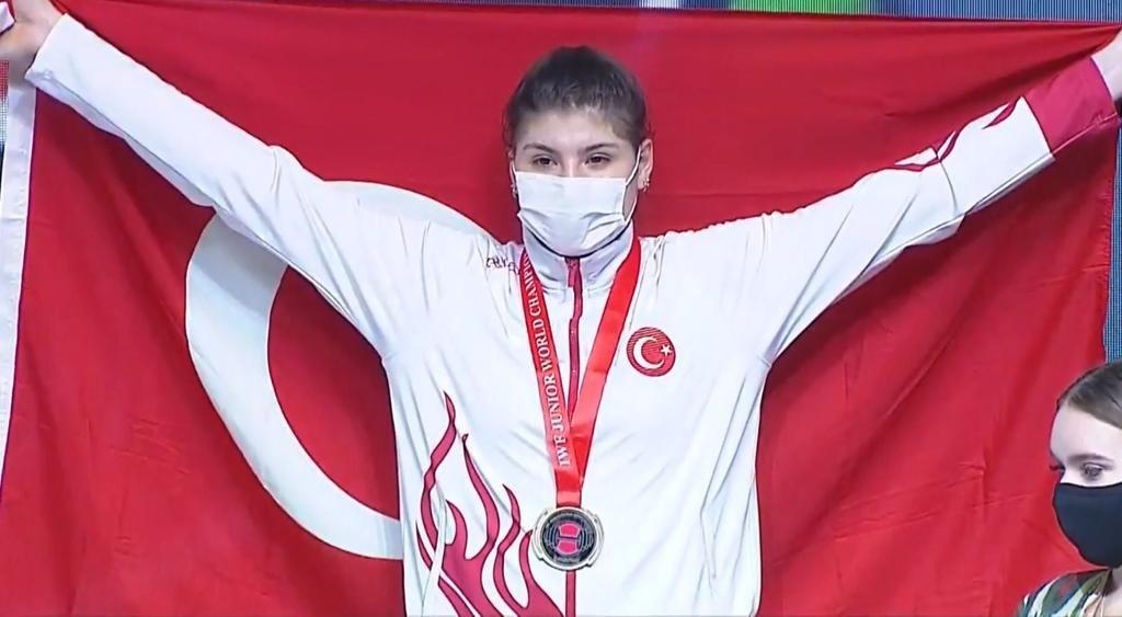 Turkish national athlete Dilara Uçan celebrates winning a gold medal at the IWF Junior World Weightlifting Championships, Tashkent, Uzbekistan, May 29, 2021. (AA Photo)